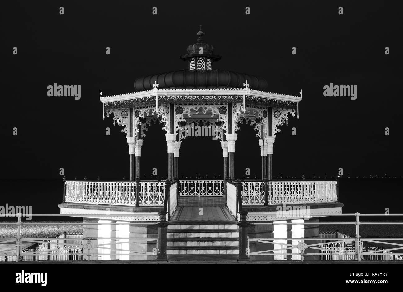 Restored Victorian bandstand on Kings Esplanade, Brighton, East Sussex, UK. Photographed at night. The bandstand is a Grade II listed building. - Stock Image