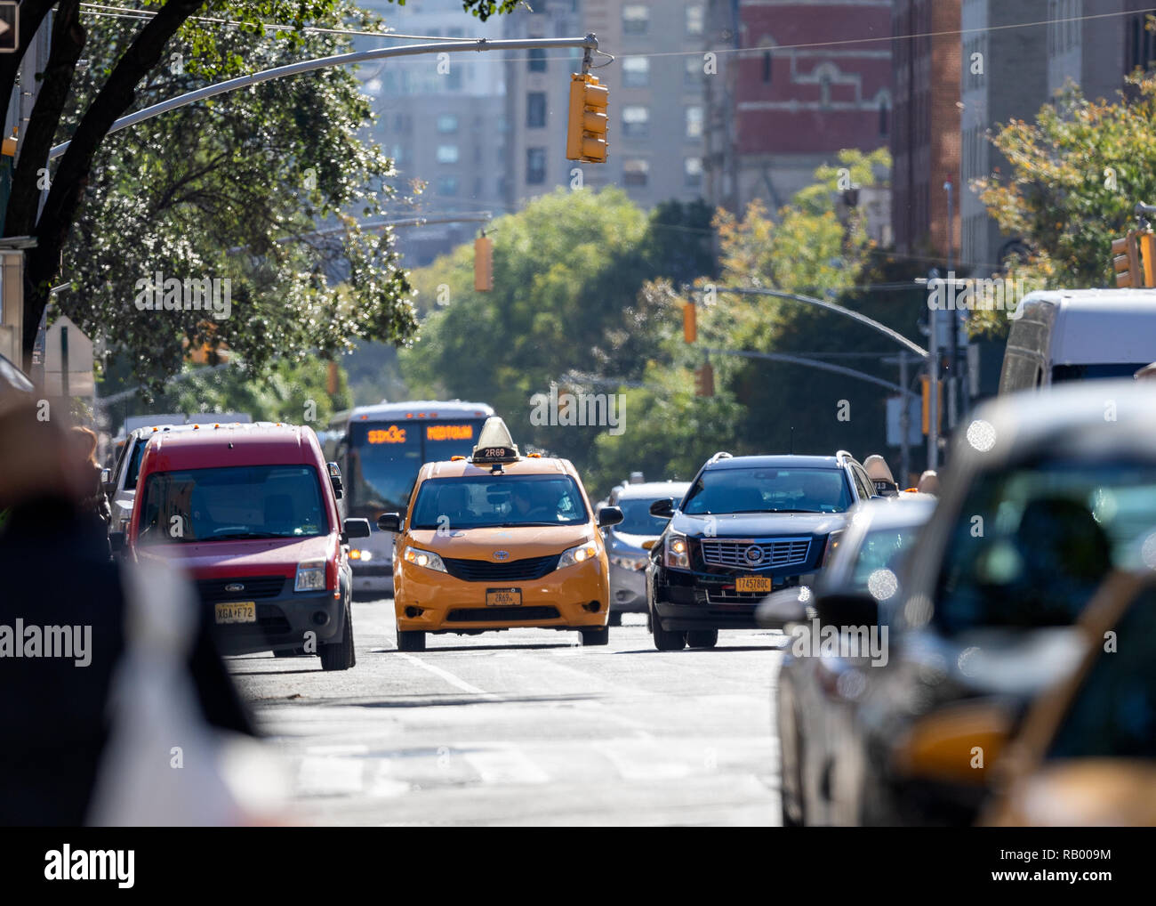 Cars on 6th Aveenue, Manhattan, Newy York City, NY, US - Stock Image