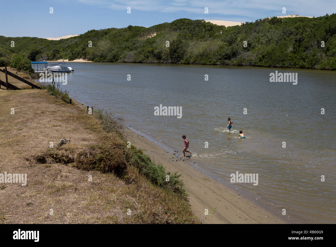 Three young children play in the Sundays River, Colchester, Eastern Cape, South Africa - Stock Image