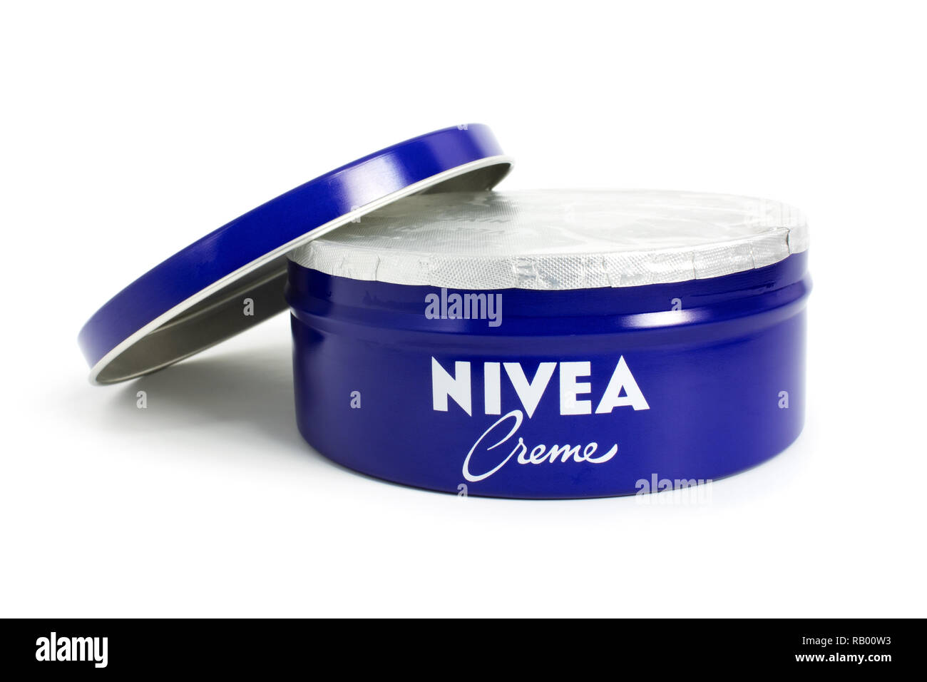Prague, CZECH REPUBLIC - DECEMBER 30, 2018: Nivea Creme, the world's famous skin cream skin cream in a metal jar laid on white background - Stock Image