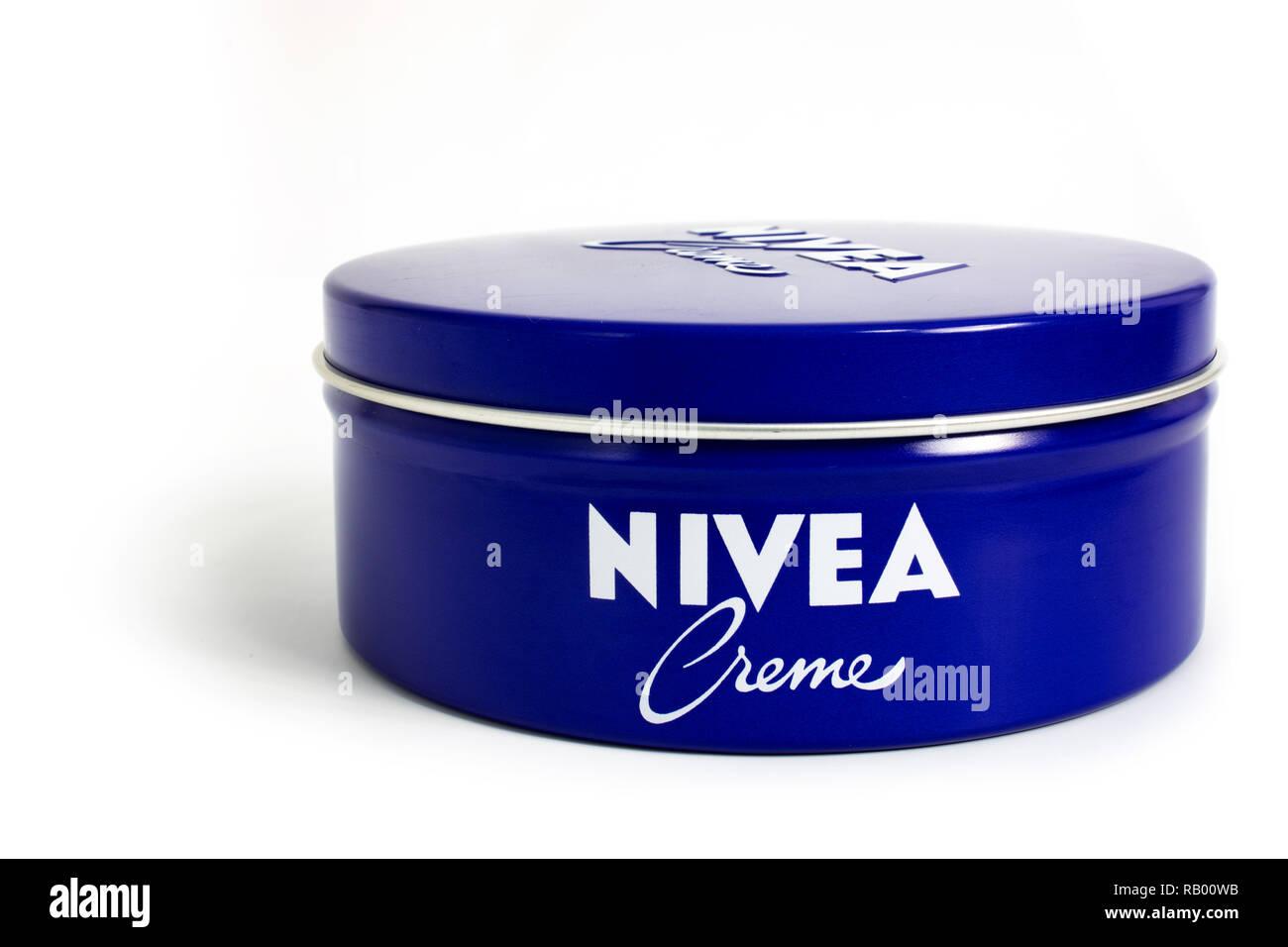Prague, CZECH REPUBLIC - DECEMBER 30, 2018: Nivea Creme, the world's famous skin cream skin cream in a metal jar laid on white background - Stock Image