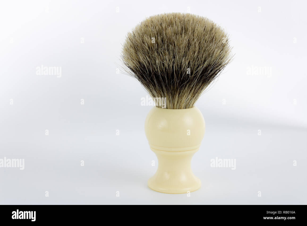 Classic hand-made pure badger shaving brush on white background