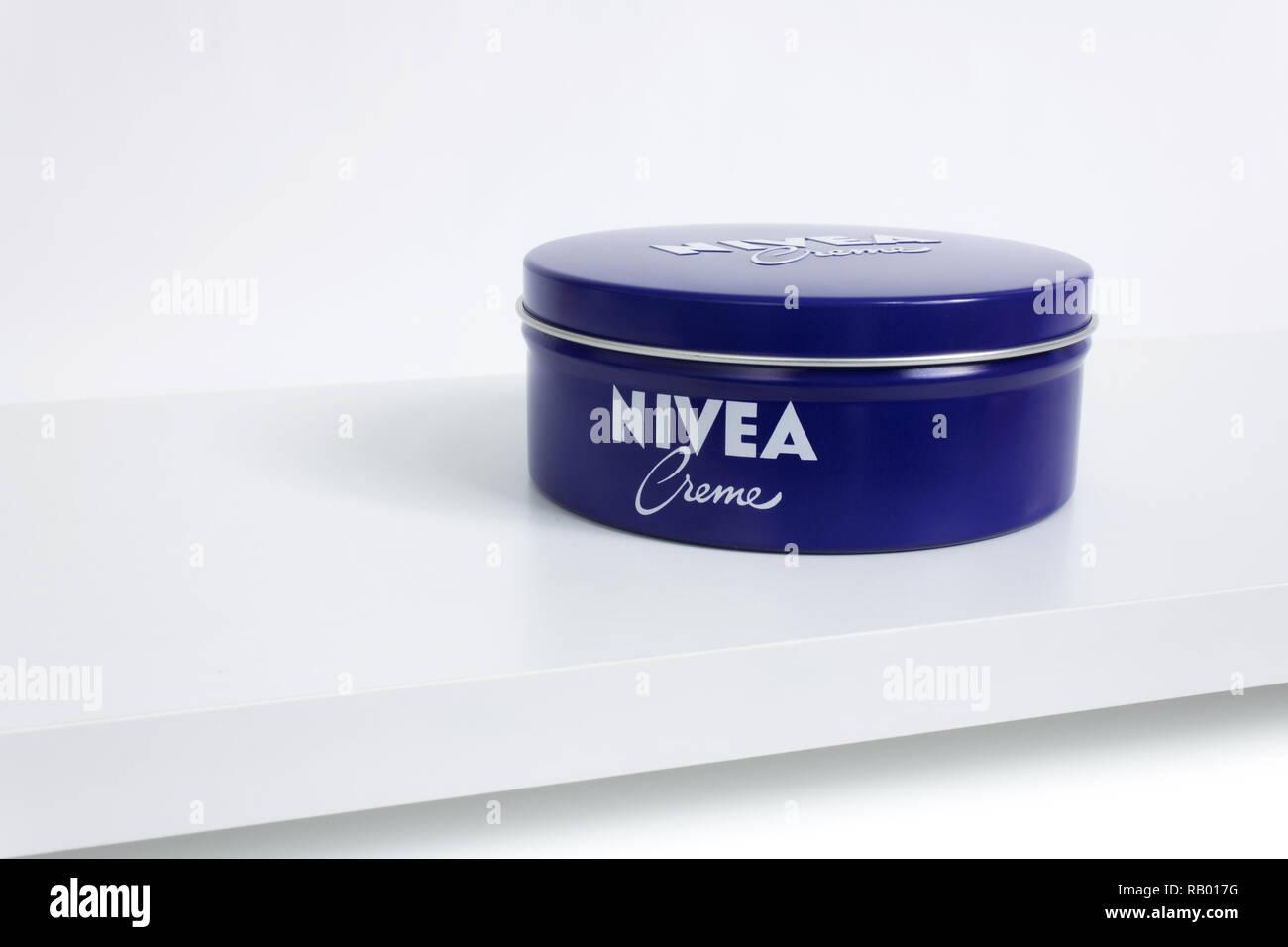 Prague, CZECH REPUBLIC - DECEMBER 31, 2018: Nivea Creme, the world's famous skin cream skin cream in a metal jar laid on white shelf Stock Photo