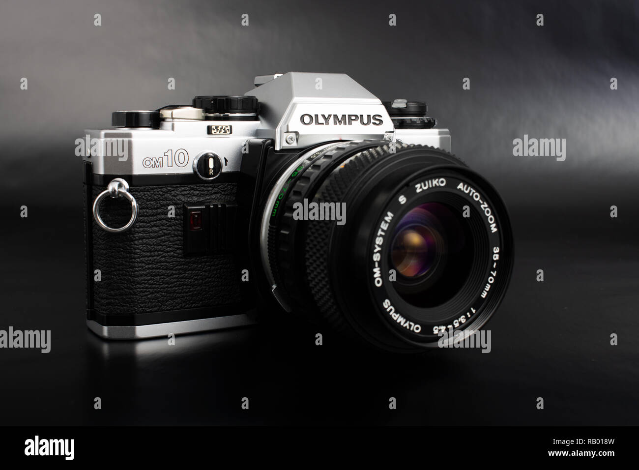 Prague, CZECH REPUBLIC - JANUARY 02, 2019: Olympus OM-10 is a 35mm film camera, launched by Olympus Corporation in June 1979, laid on dark background - Stock Image