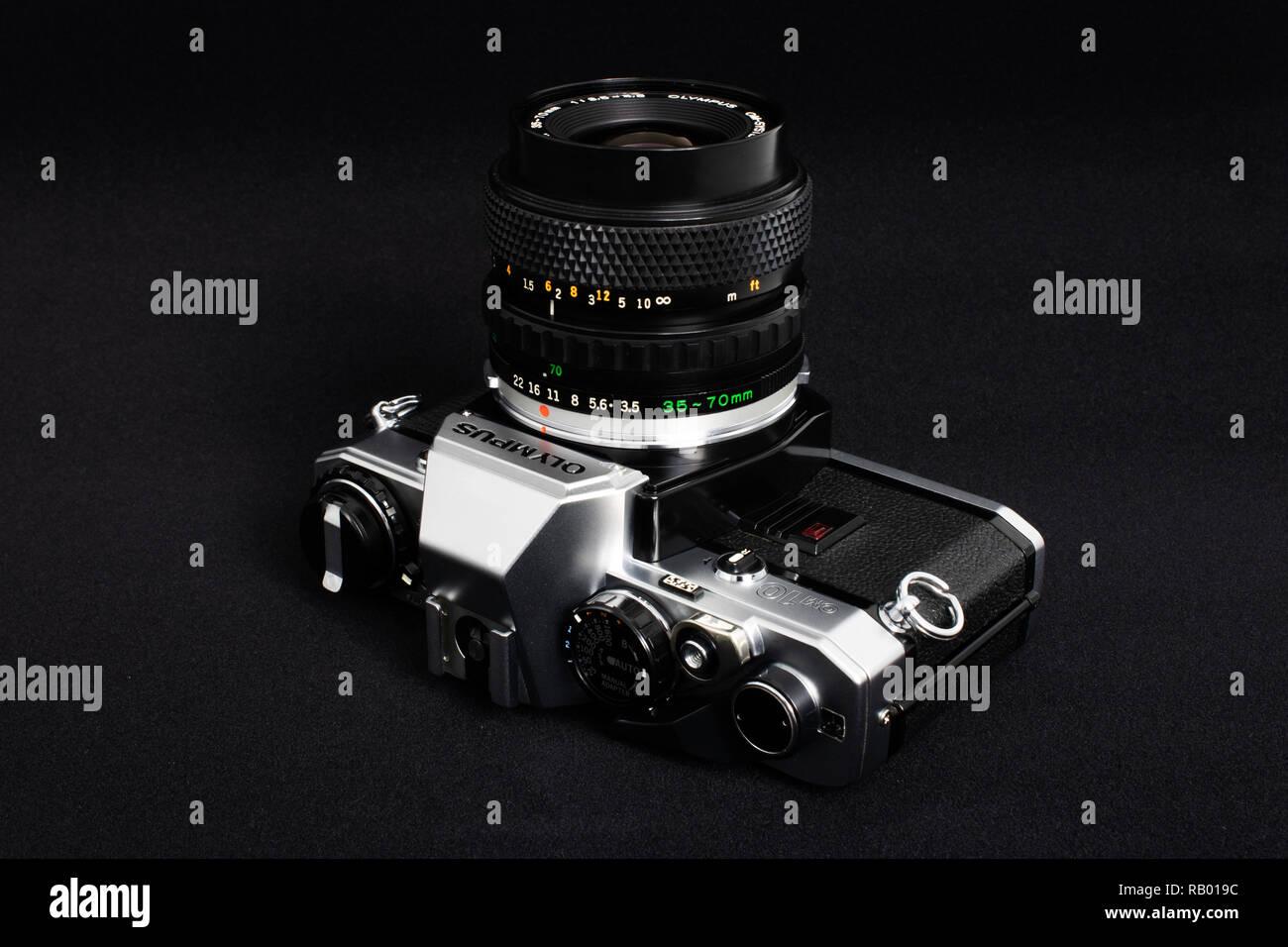 Prague, CZECH REPUBLIC - JANUARY 03, 2019: Olympus OM-10 is a 35mm film camera, launched by Olympus Corporation in June 1979, laid on dark background - Stock Image