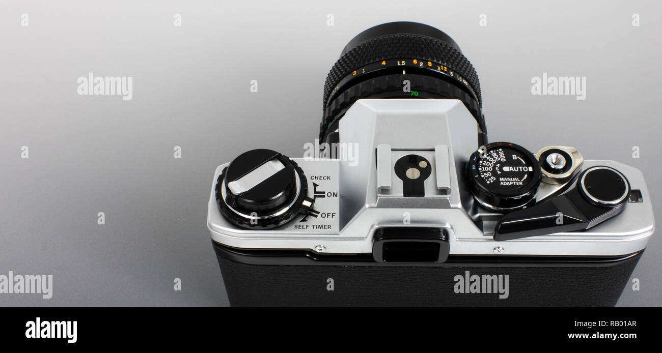 Old SLR camera for 35mm film strip, top angle view as photographer - Stock Image