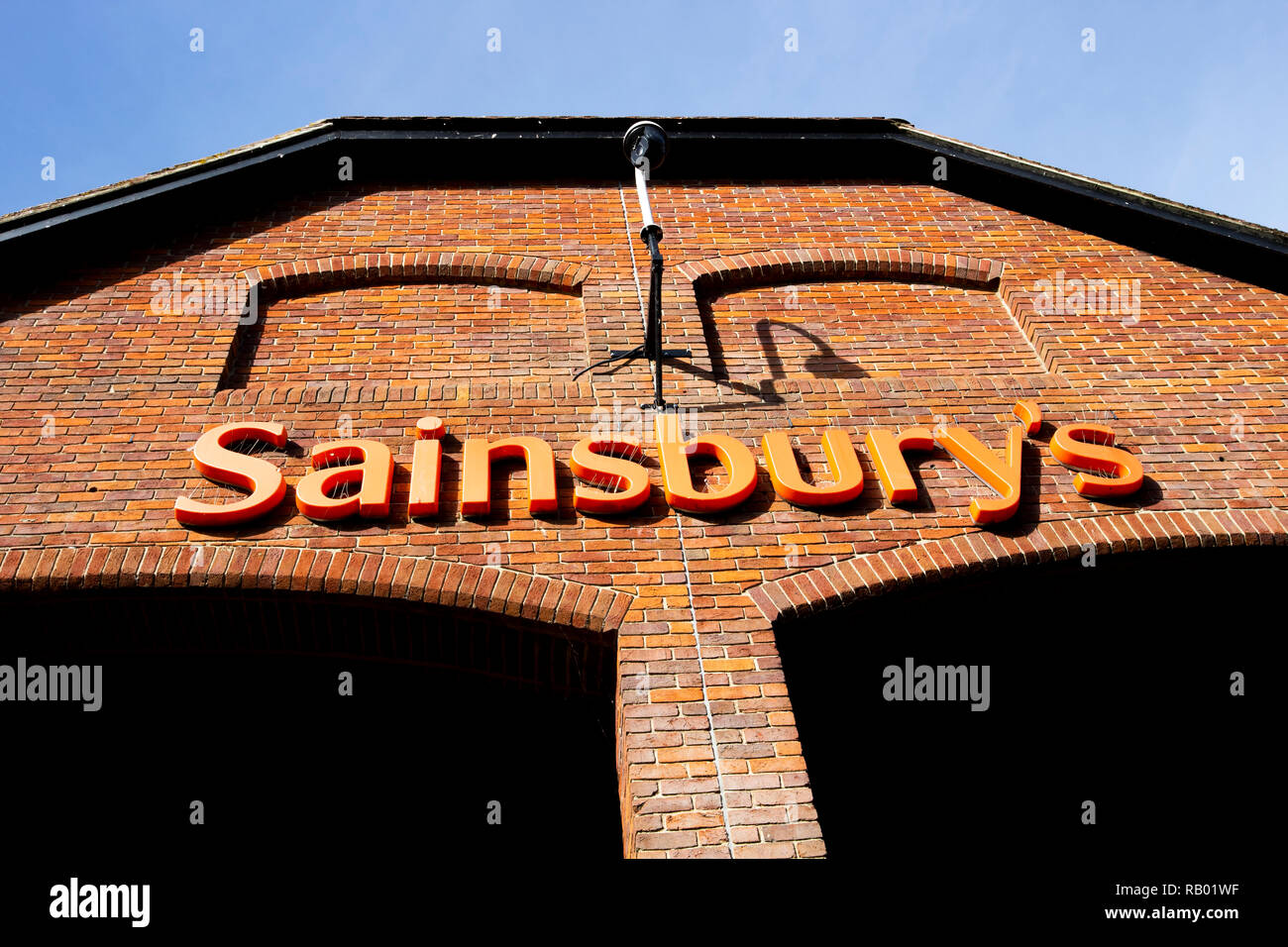 Sainsburys supermarket sign over entrance, founded in 1869 by John James Sainsbury with a shop in Drury Lane London - Stock Image