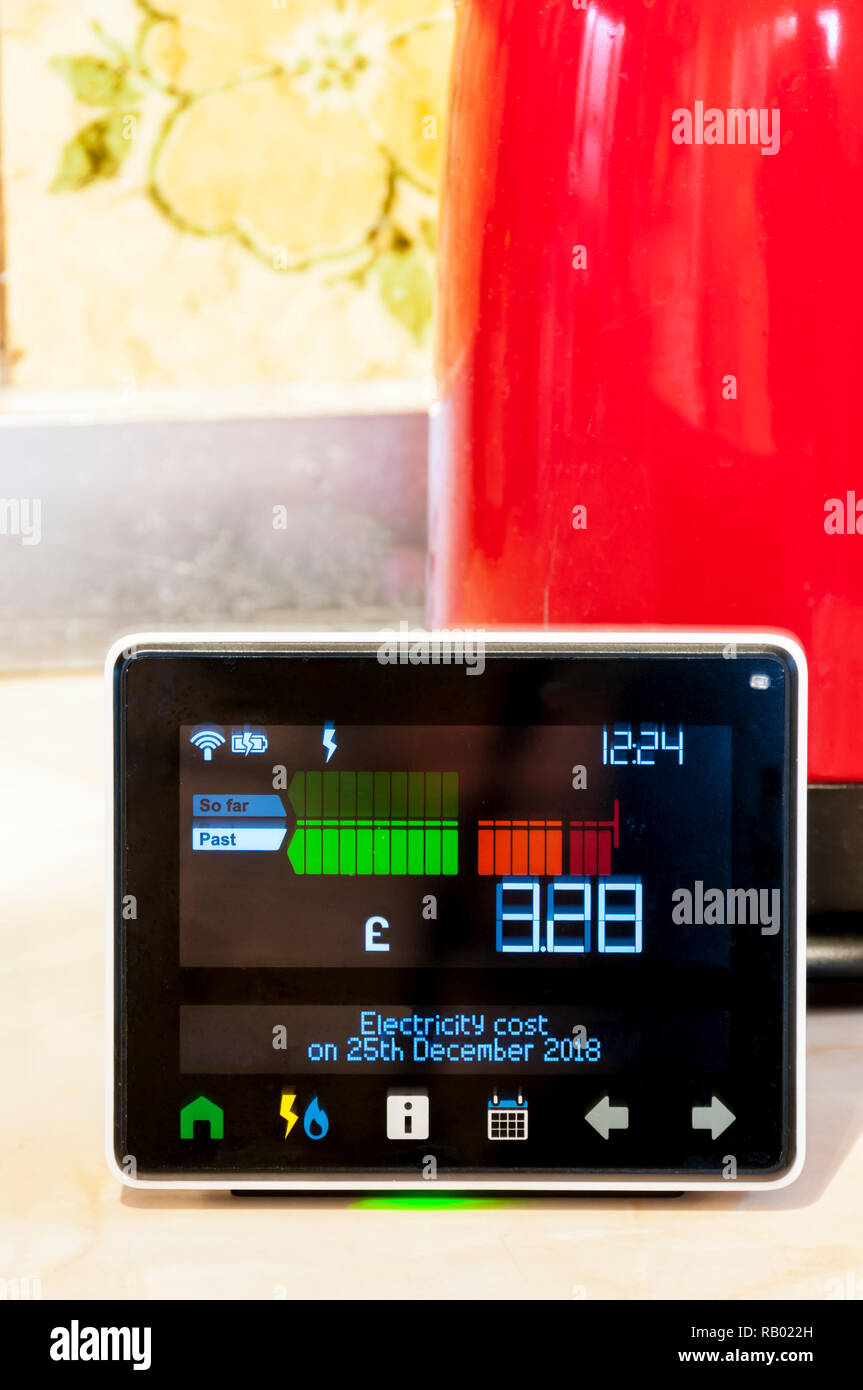 A Chameleon Technology Smart Meter provided by EDF Energy in a domestic kitchen.  Shows cost of energy consumed during day. - Stock Image