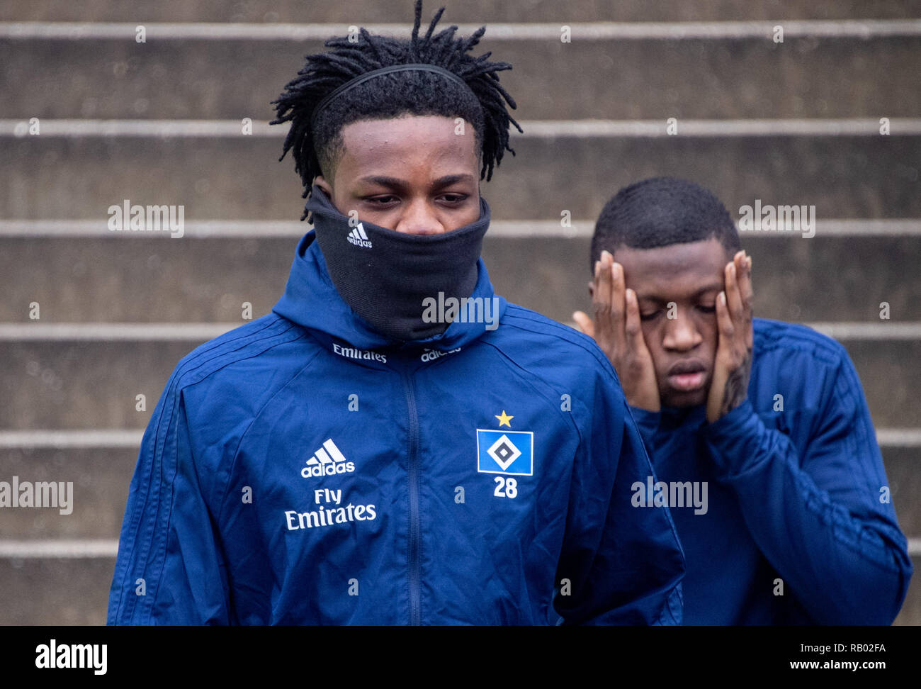 Hamburg, Germany. 05th Jan, 2019. Soccer, 2nd Bundesliga: Hamburg's Gideon Jung (l) and Hamburg's Orel Mangala enter the pitch at the start of Hamburger SV training. Credit: Axel Heimken/dpa/Alamy Live News - Stock Image