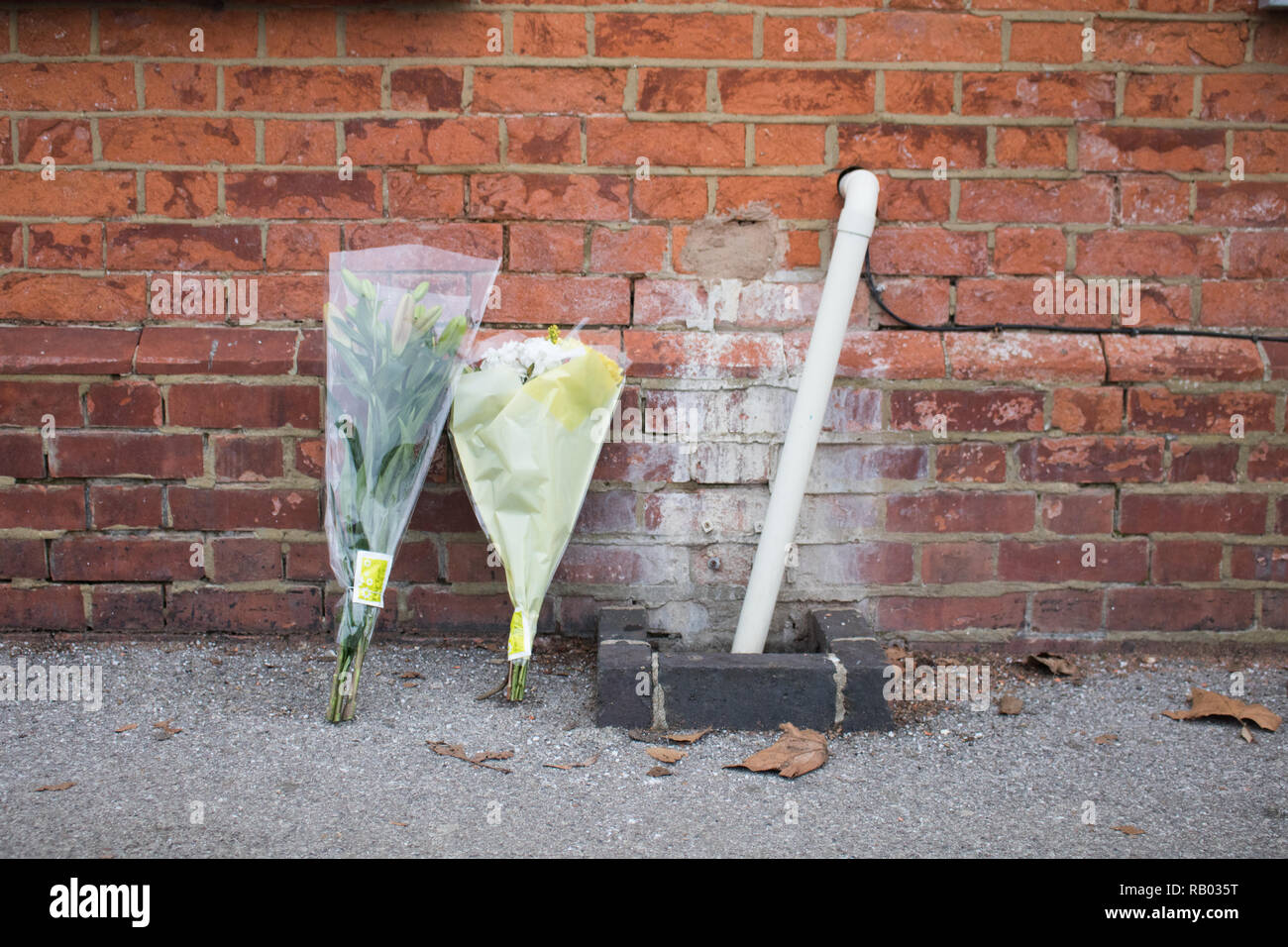 Horsley Surrey, 5th January 2019.  Floral tributes left outside    Horsley Station  platform in Surrey where a man who has been named as Lee Pomeroy aged 51 was discovered fatally stabbed on an inbound  train from Guilford to Waterloo on Friday Credit: amer ghazzal/Alamy Live News - Stock Image