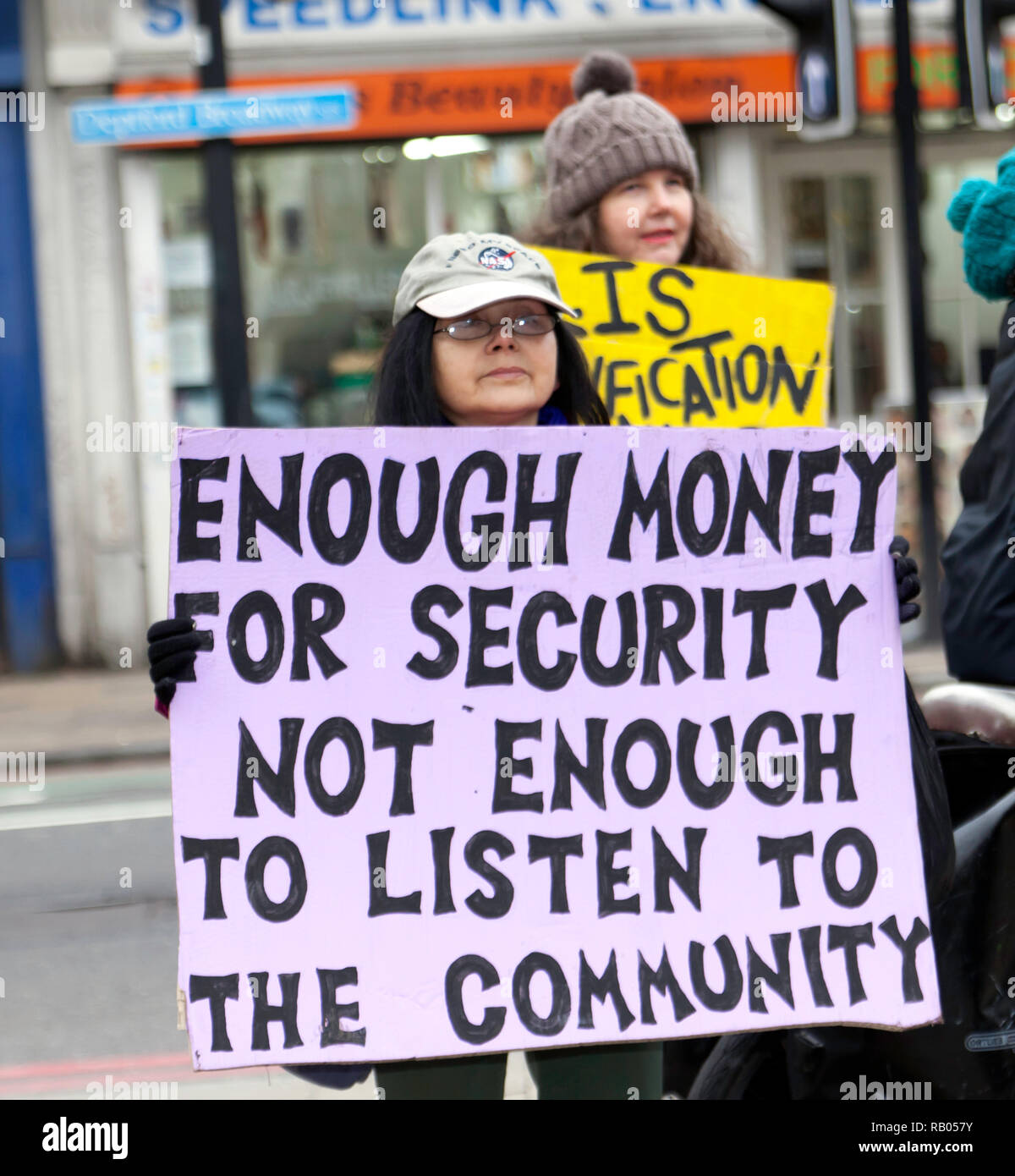 Close-up of a Protestor,  carrying a banner and  standing at the junction of  Deptford High Street and Deptford Broadway,  during a campaign to save Reginald House and Old Tidemill Wildlife Garden, from destruction by Lewisham Council,  Deptford, Lewisham, South East London. - Stock Image