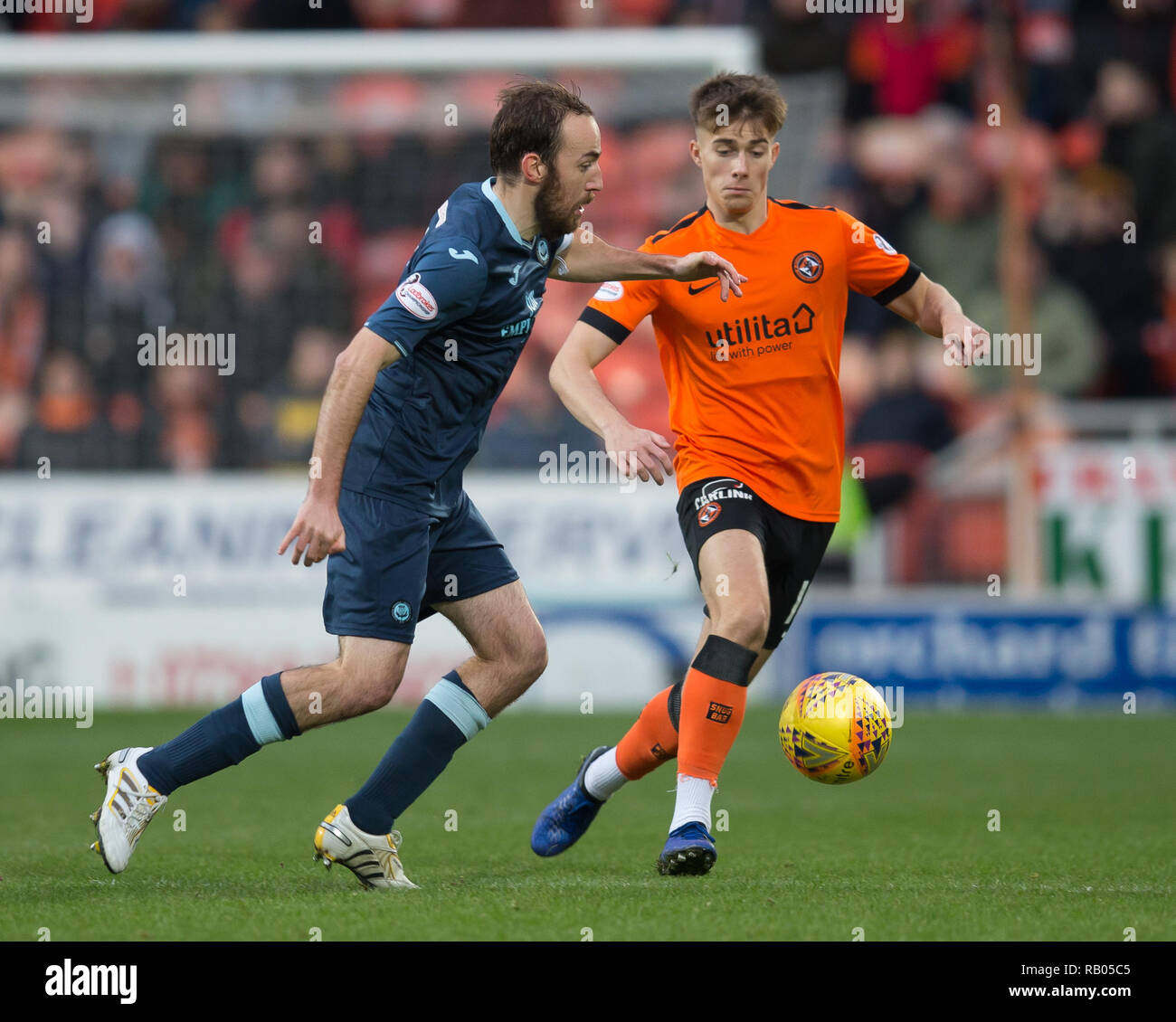 Tannadice Park, Dundee, UK. 5th Jan, 2019. Scottish Championship football, Dundee United versus Partick Thistle; Stuart Bannigan of Patrick Thistle and Matthew Smith of Dundee United Credit: Action Plus Sports/Alamy Live News - Stock Image