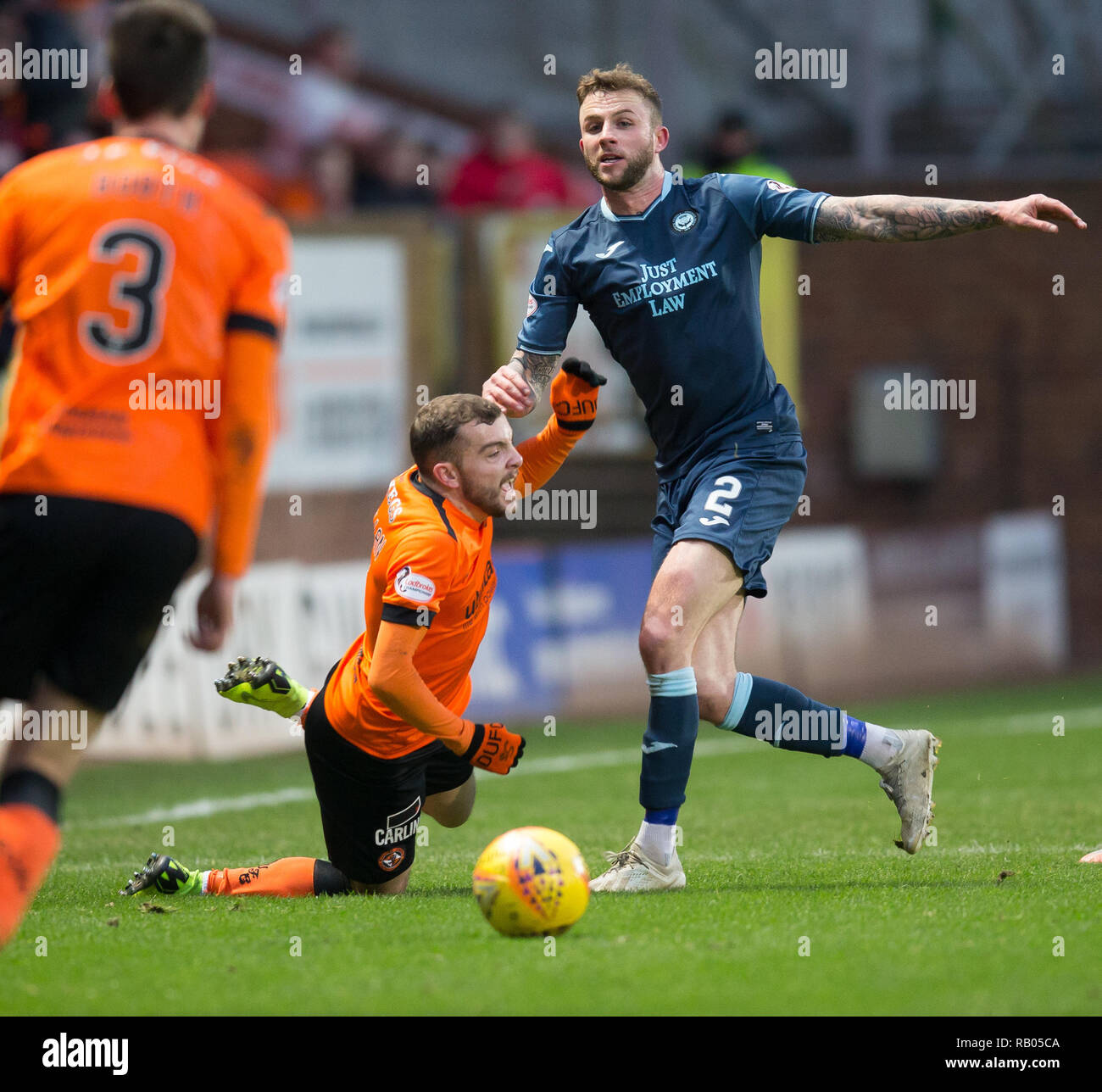 Tannadice Park, Dundee, UK. 5th Jan, 2019. Scottish Championship football, Dundee United versus Partick Thistle; Paul McMullan of Dundee United is tackled by Christie Elliott of Patrick Thistle Credit: Action Plus Sports/Alamy Live News - Stock Image