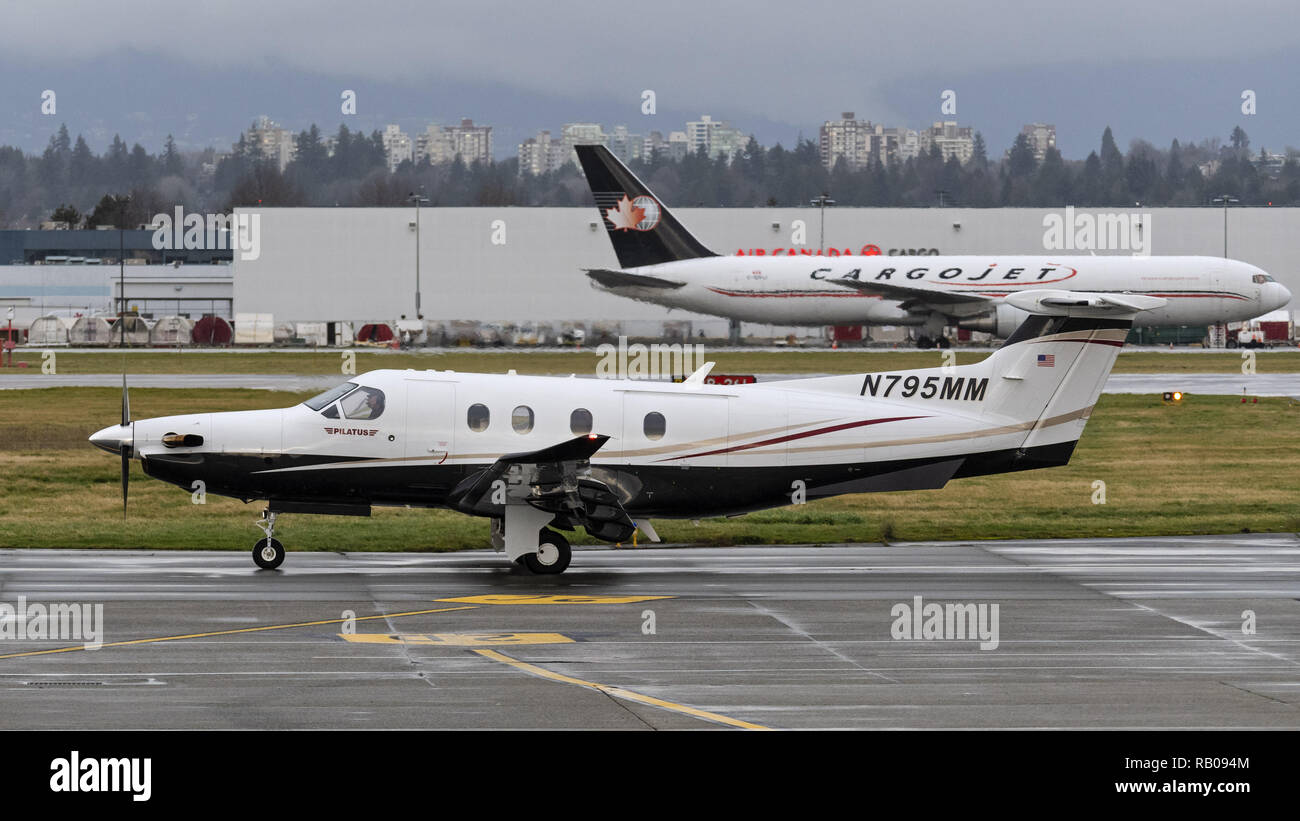 Richmond, British Columbia, Canada. 4th Jan, 2019. A Pilatus PC-12 (PC12-47E) single-engine turboprop airplane taxies along the tarmac at Vancouver International Airport. Credit: Bayne Stanley/ZUMA Wire/Alamy Live News - Stock Image