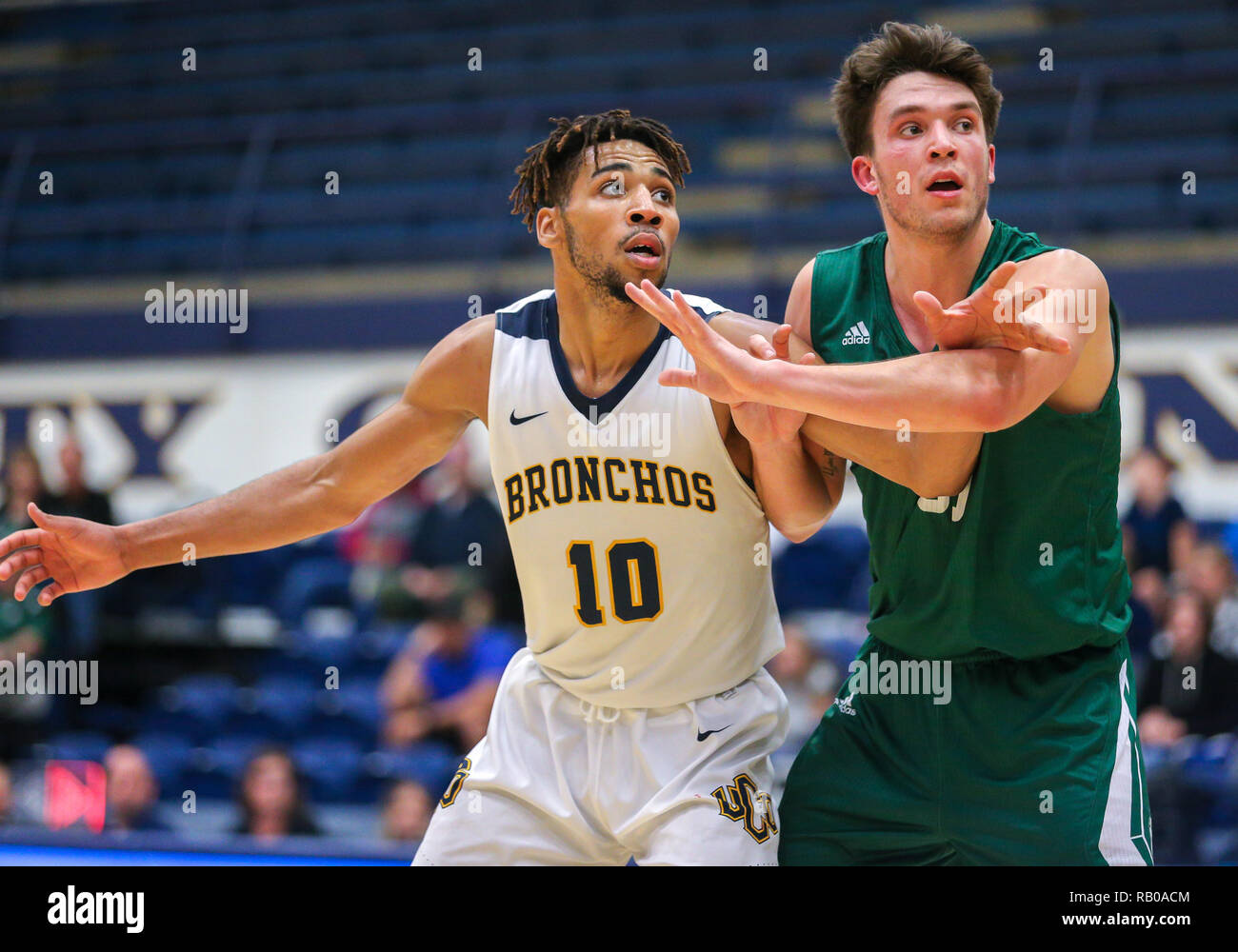 Oklahoma, USA. 5th Jan, 2019. University of Central Oklahoma Forward Adarius Avery (10) and Northwest Missouri Guard Joey Witthus (30) battle for position during a basketball game between the Northwest Missouri Bearcats and the Central Oklahoma Bronchos at Hamilton Field House in Edmond, OK. Gray Siegel/CSM/Alamy Live News Stock Photo