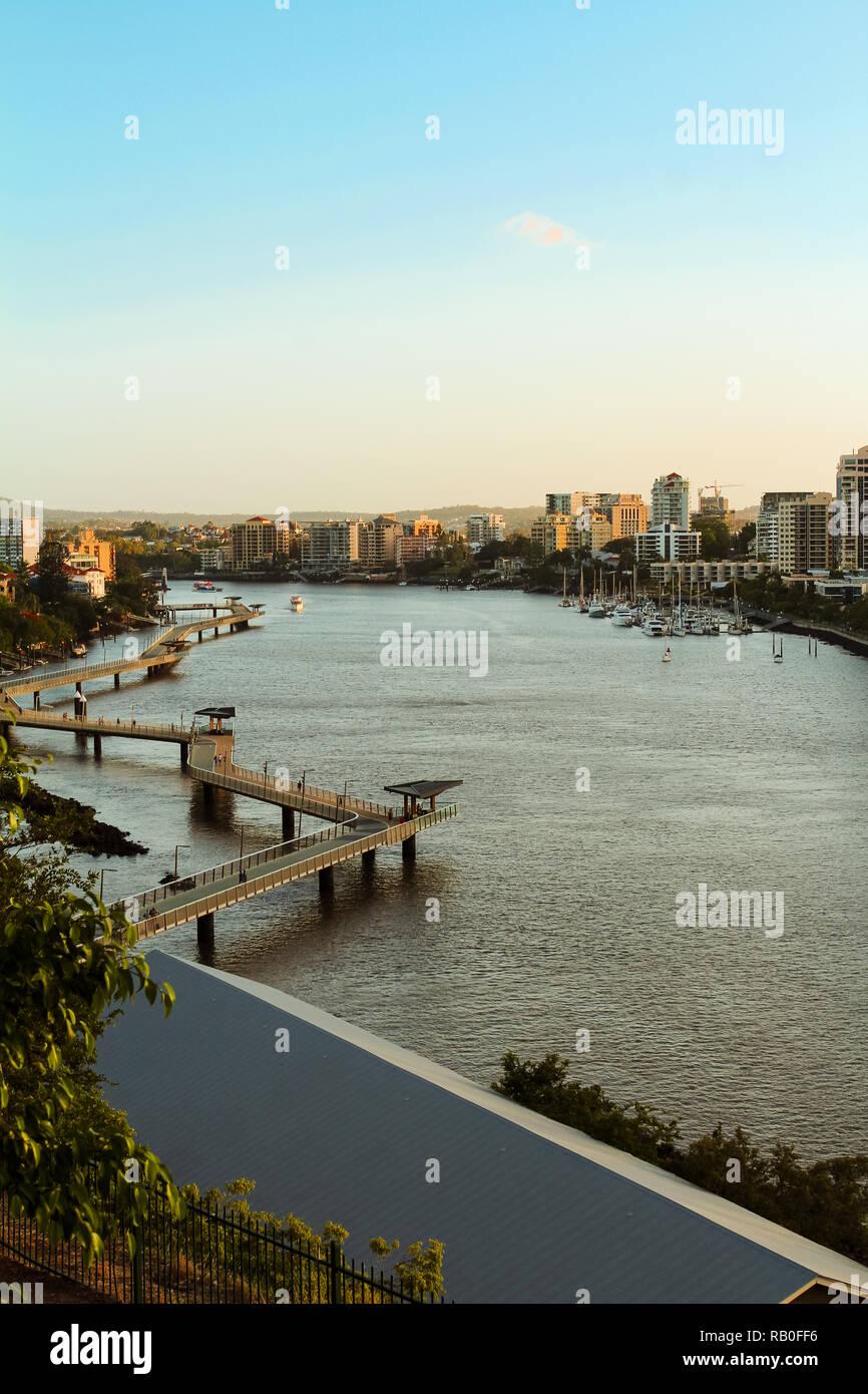 Brisbane skyline during sunset in summer as seen from a higher position with Brisbane River (Brisbane, Queensland, Australia) - Stock Image