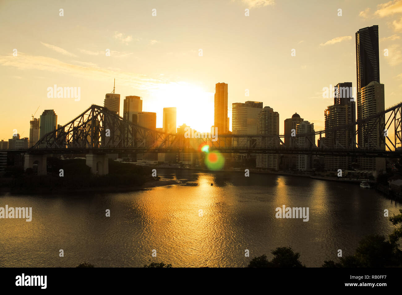 Skyline of Brisbane with Story Bridge during sunset in the background right before dawn during summer (Brisbane, Queensland, Australia) - Stock Image