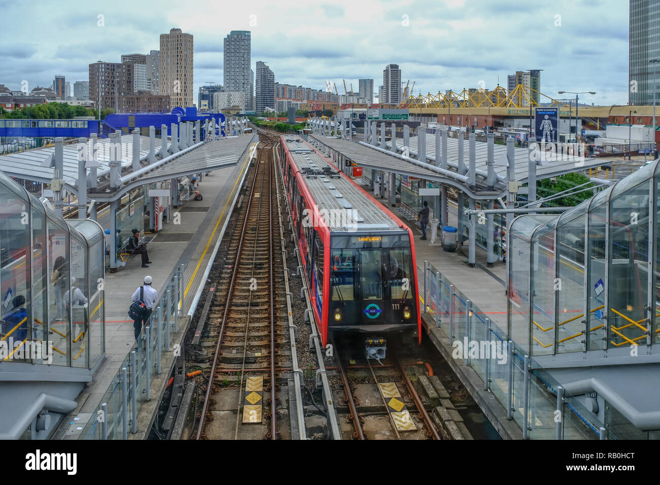 Poplar, London, UK - August 18,l 2018: Poplar DLR train station.  View looking down towards a train that has just arrived. - Stock Image