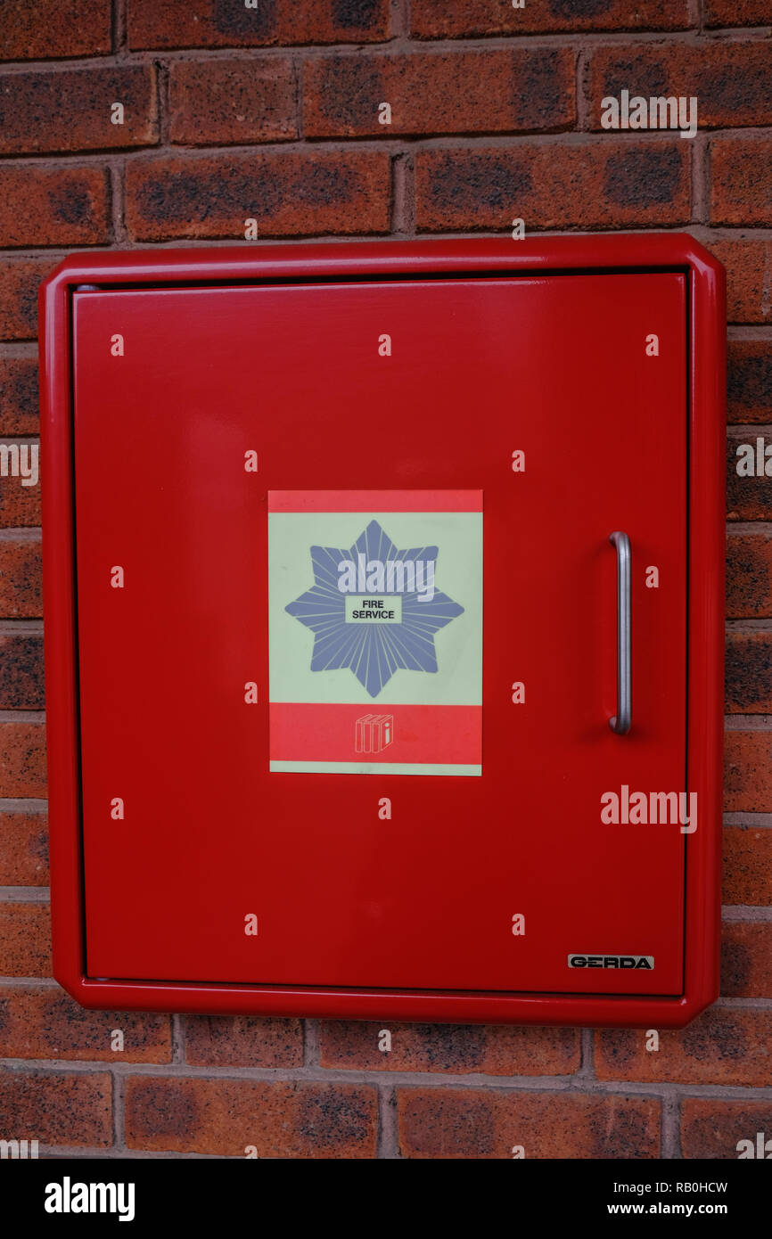 Poplar, London, UK - August 18, 2018: Red Gerda PIB emergency box for the firebrigade.  Contains plans of the building.  Close up shot of a closed box - Stock Image