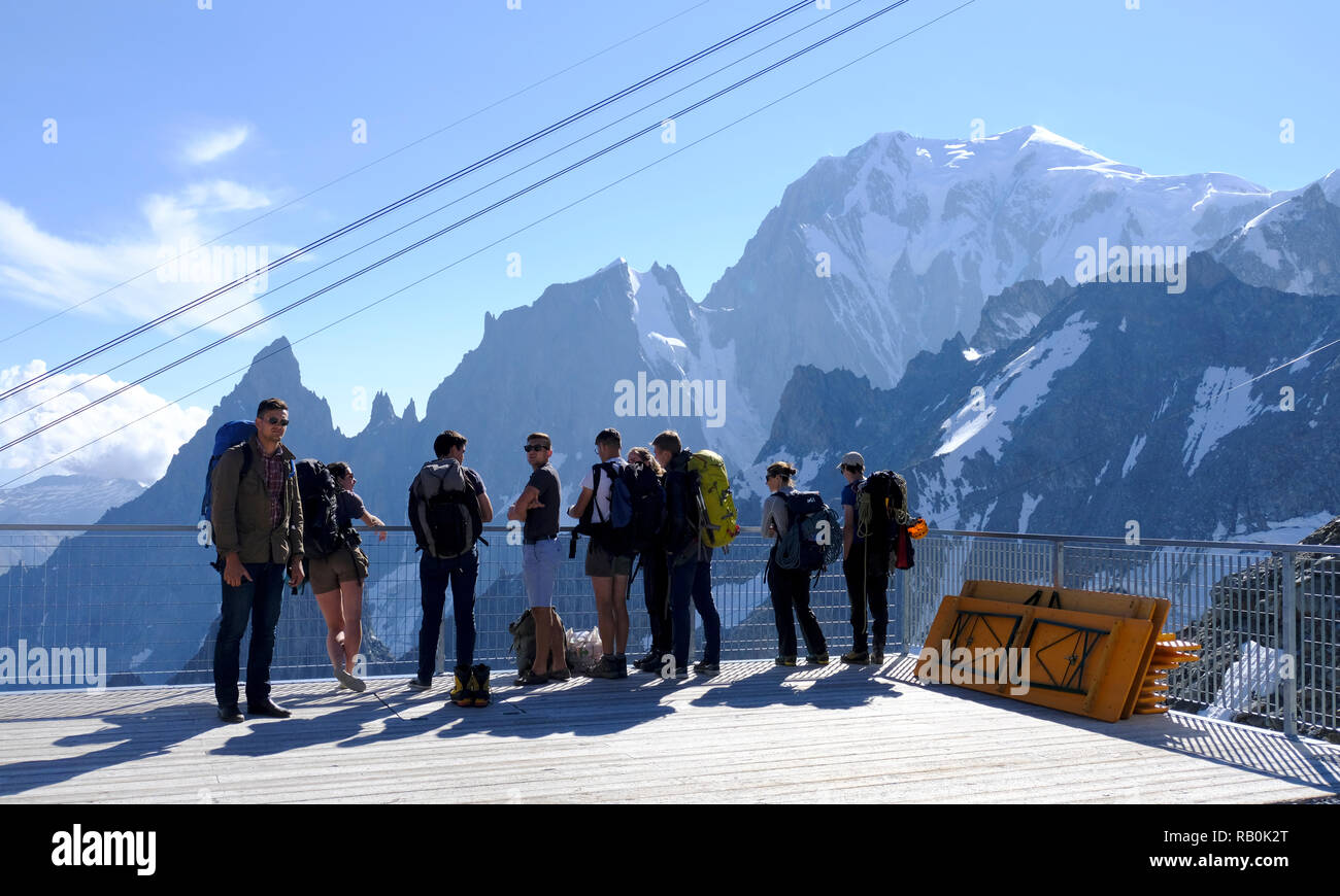 Tourists on the panoramic terrace Skyway Monte Bianco on the Italian side of Mont Blanc. Italy. - Stock Image