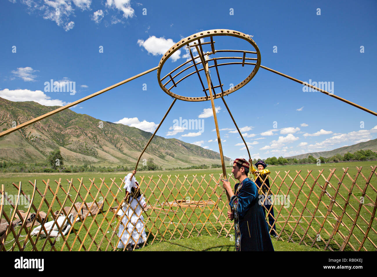 Kazakh people building a nomadic tent known as yurt. - Stock Image
