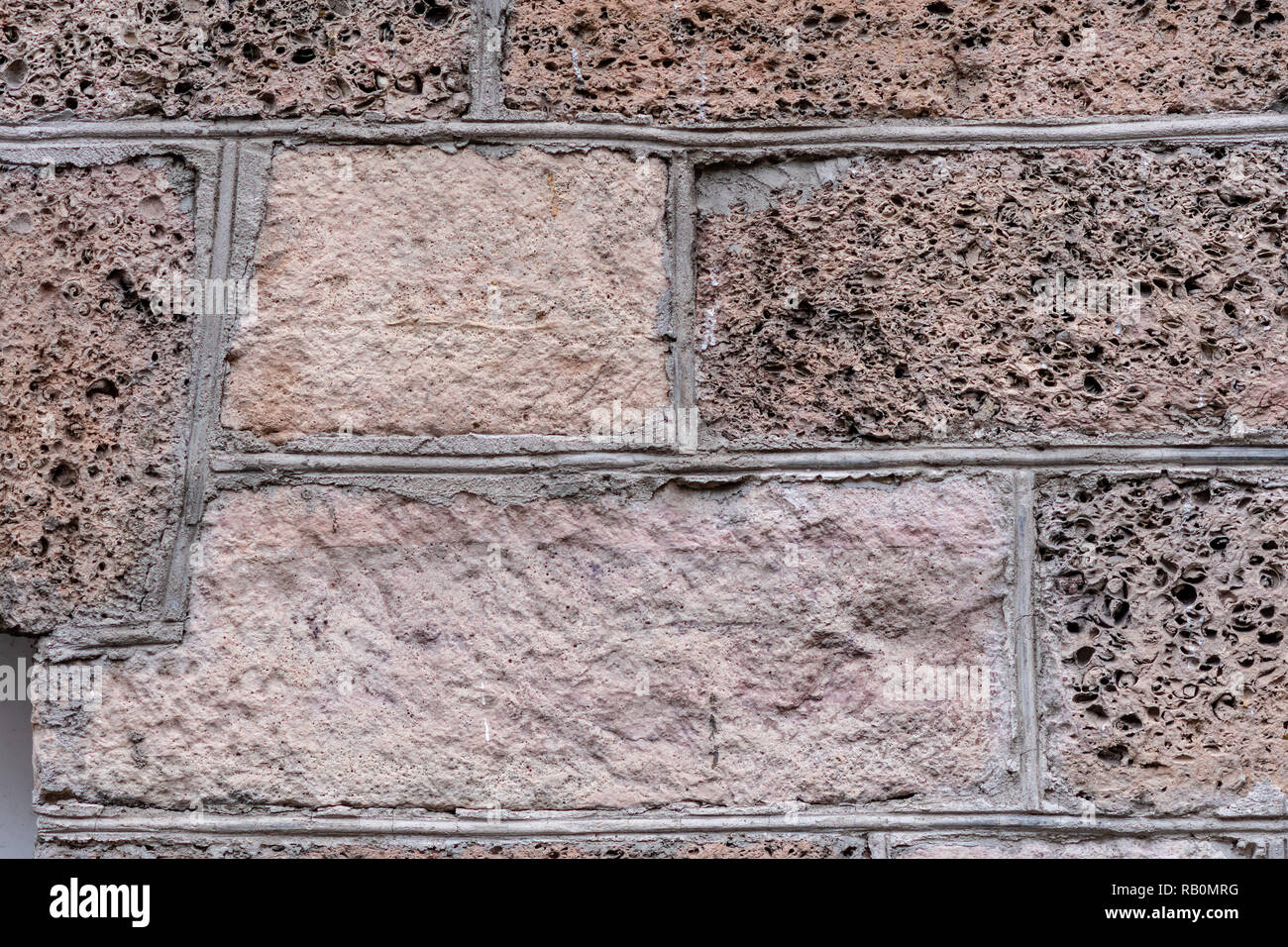 Close-up photo. Fragment of an old masonry wall. - Stock Image