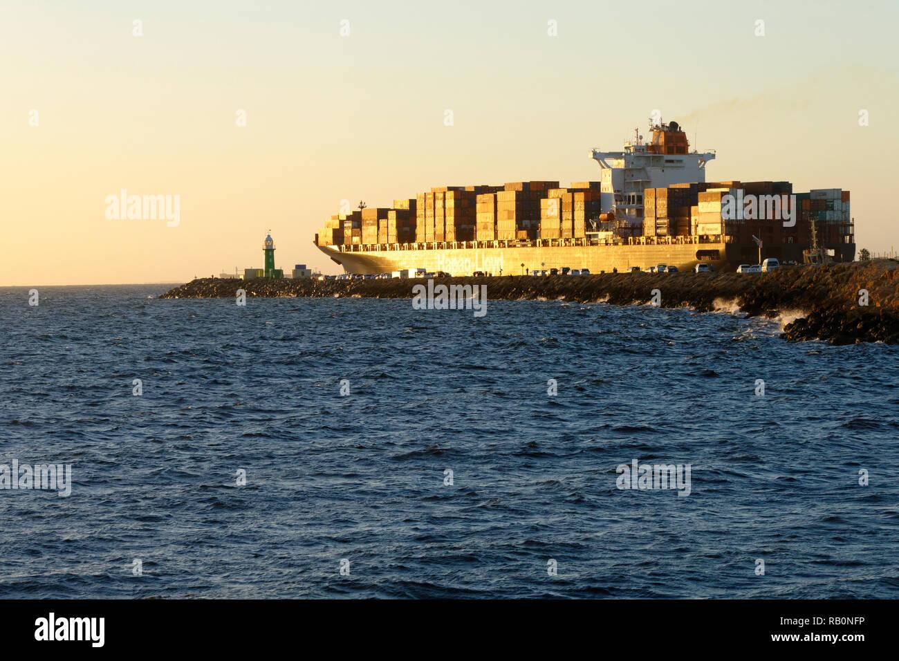 Container ship Al Hilal Monrovia  passing south mole as it leaves Fremantle harbour, Fremantle, Western Australia - Stock Image