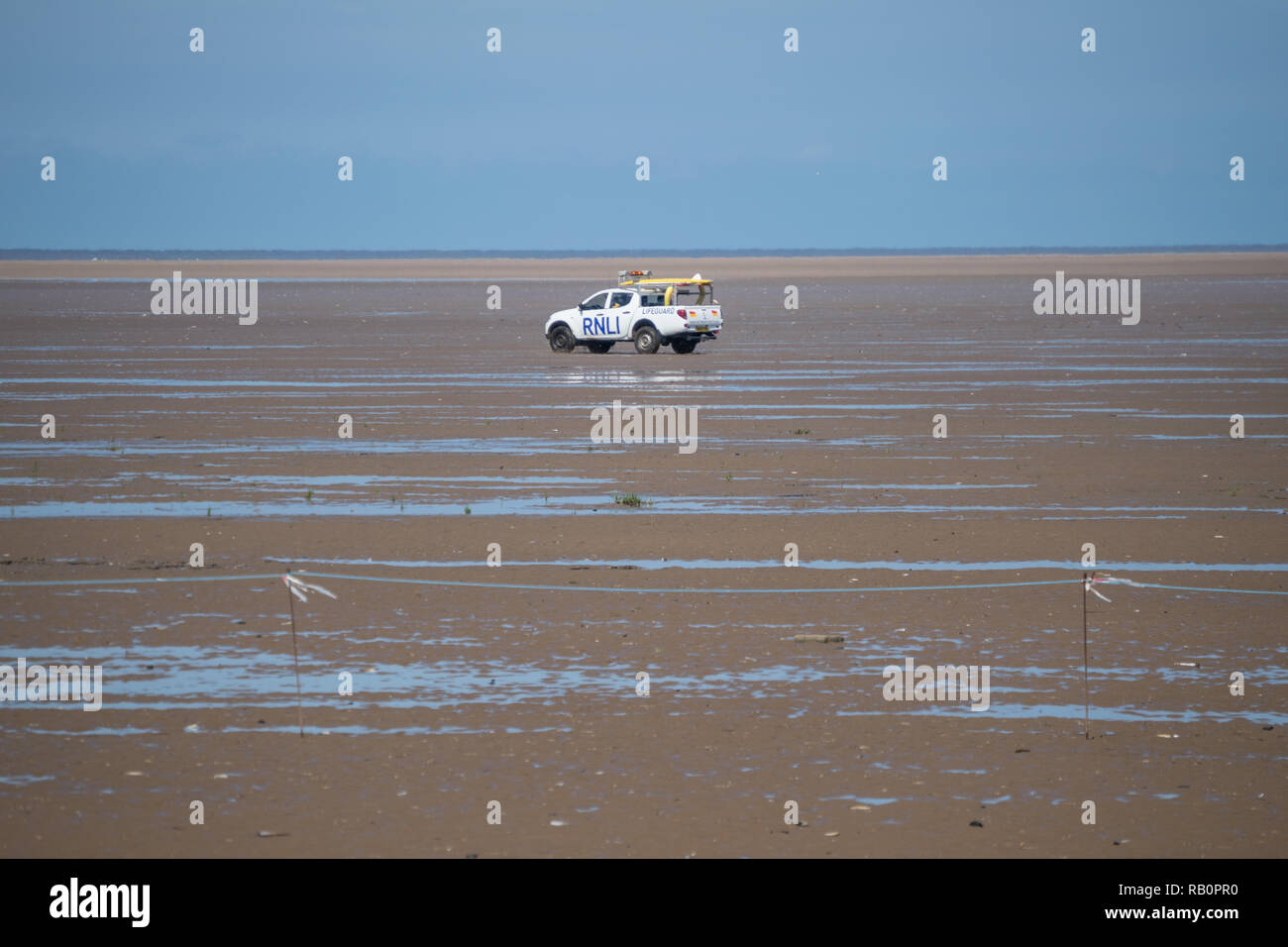 RNLI Lifeboat Rescue vehicle patrols the beach in Southport Lancashire - Stock Image