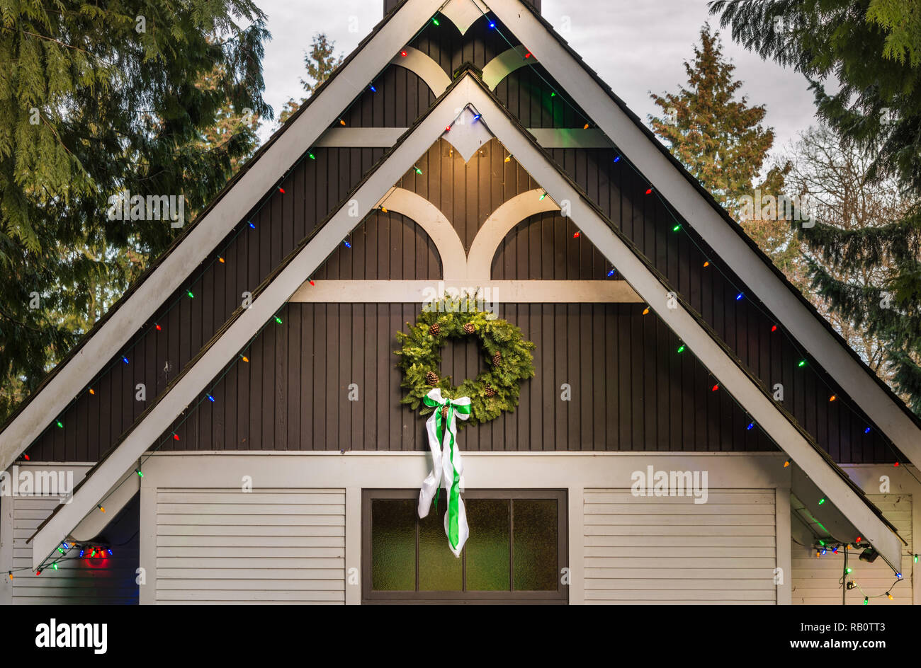 1920's style Christian wooden church with traditional evergreen wreath. Burnaby Village Museum, BC, Canada, during annual Heritage Christmas event. - Stock Image