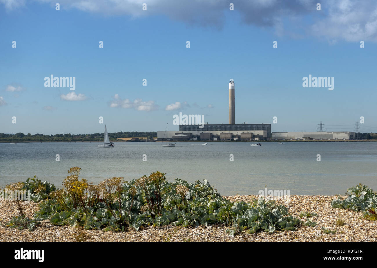 View from Hamble Common Beach across the Solent (Southampton Water) towards Fawley Refinery and Power Station in Southampton, Hampshire, England, UK Stock Photo