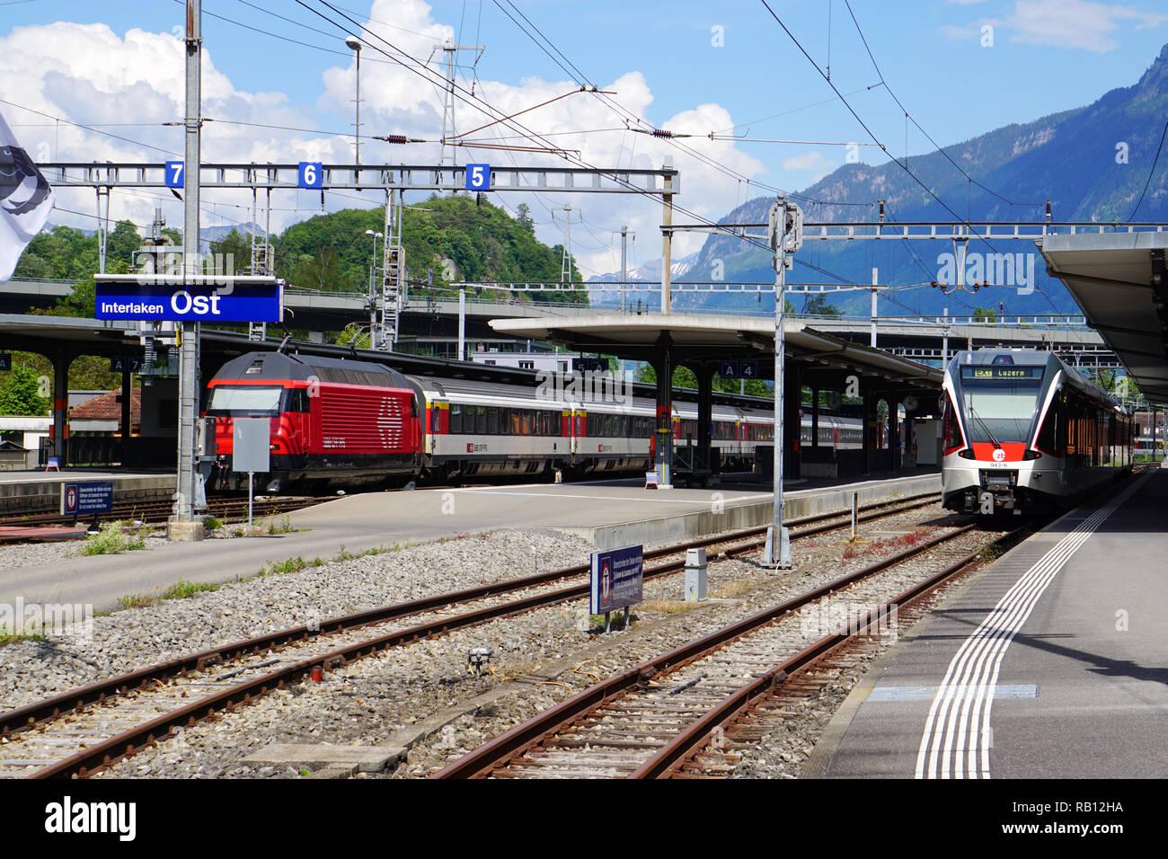 Trains at the Interlaken Ost railway station - Stock Image