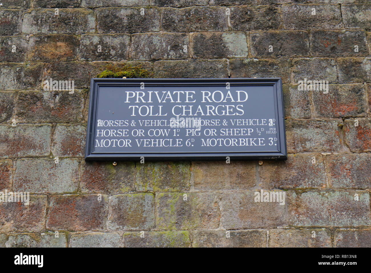 A sign with a list of Victorian Toll Charges to cross over Hebden Beck Bridge at Gibson Mill in Hebden Bridge. - Stock Image