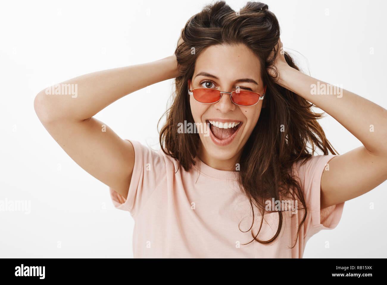 c38be9e5c0f Hey look on bright side. Portrait of charming stylish and confident  euroepan female winking joyfully