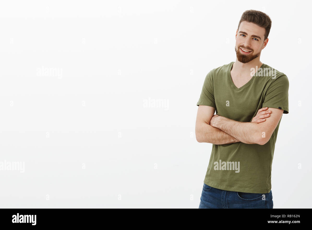 Come on, quit joking, let get to business. Portrait of handsome enthusiastic bearded guy in confident pose cross hands against body and smirking delighted, assured over white background - Stock Image