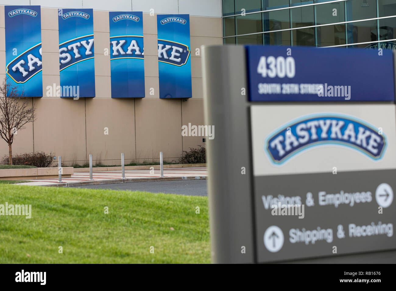 A logo sign outside of the headquarters of the Tasty Baking Company, maker of Tastykake products, in Philadelphia, Pennsylvania, on December 23, 2018. - Stock Image