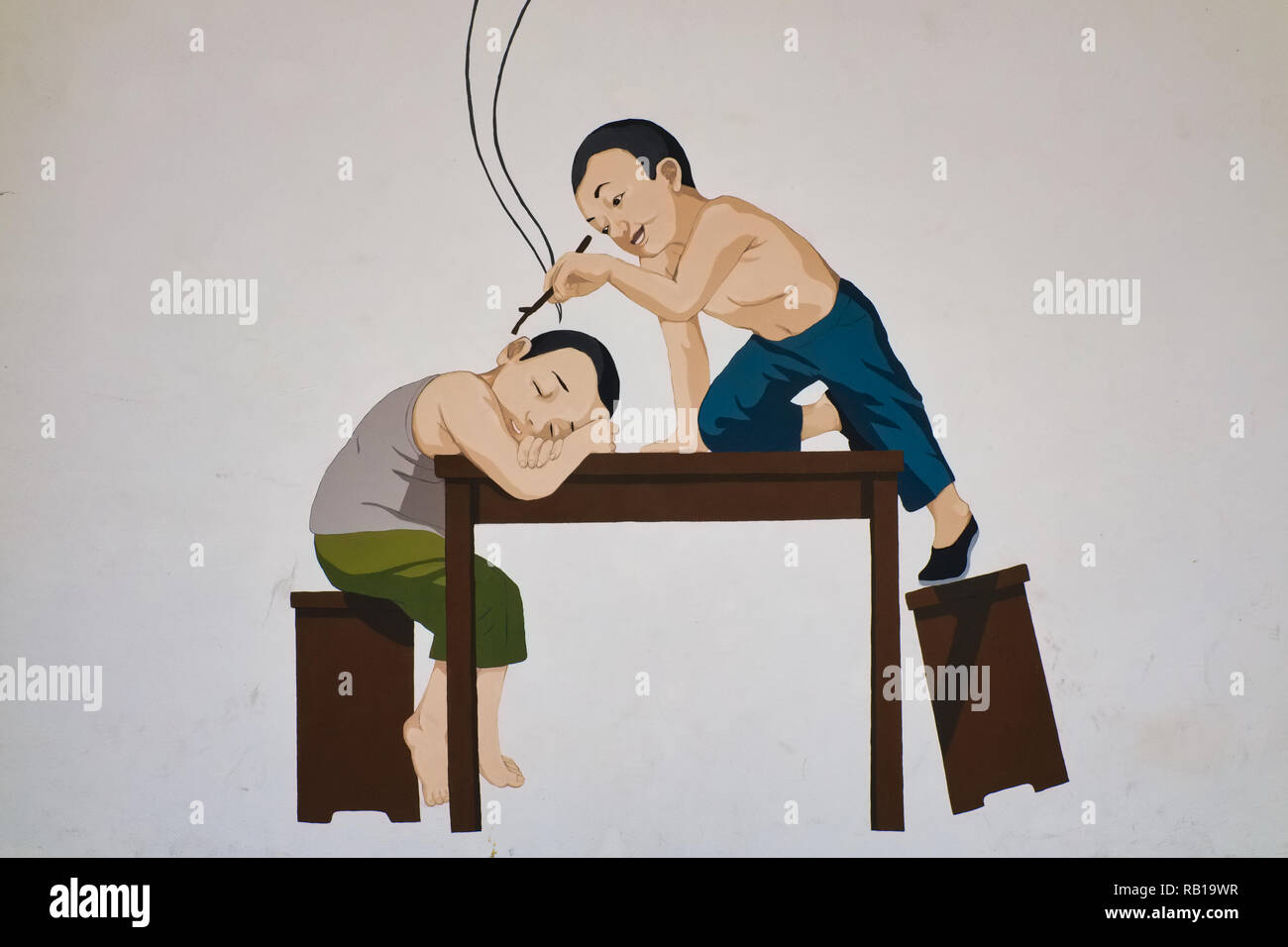 A wall painting in Far East Square, Chinatown, Singapore, depicting a Chinese boy of days gone by teasing his sleeping friend - Stock Image