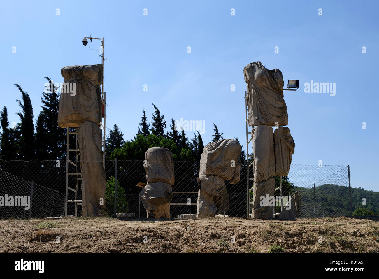 Fragments of 8-metre-high statues of Apollo, Artemis and Leto that once stood inside the Temple of Apollo of Claros, Turkey. - Stock Image