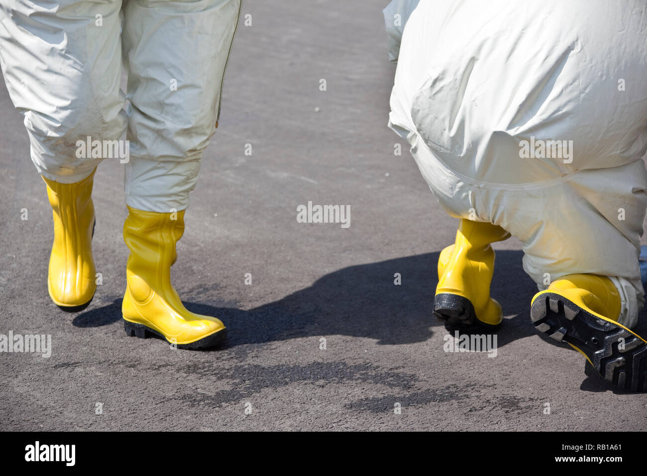 Two men in protective gear. The inflatable gear protects against contamination with radioactive particles, against Alpha radiation and partially again - Stock Image