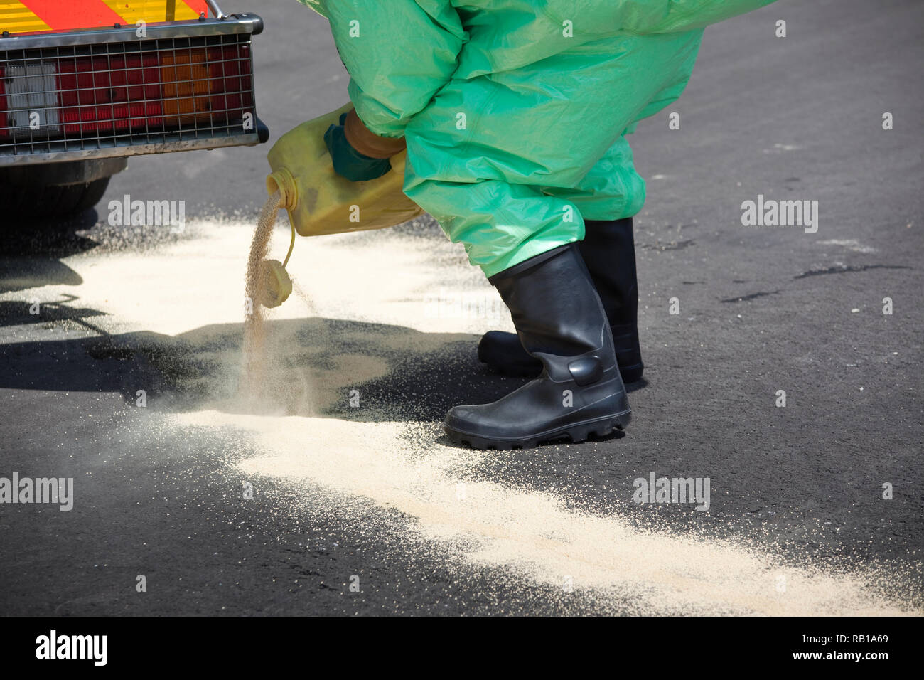 Man in protective gear cleaning up after chemical disaster. The inflatable gear also protects against contamination with radioactive particles, agains Stock Photo
