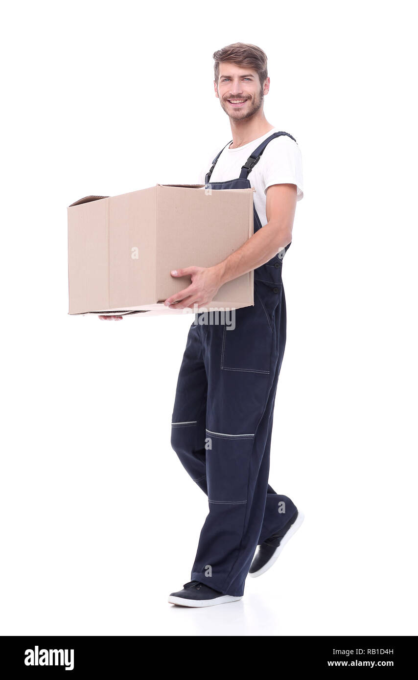 in full growth.a man carries a large cardboard box - Stock Image