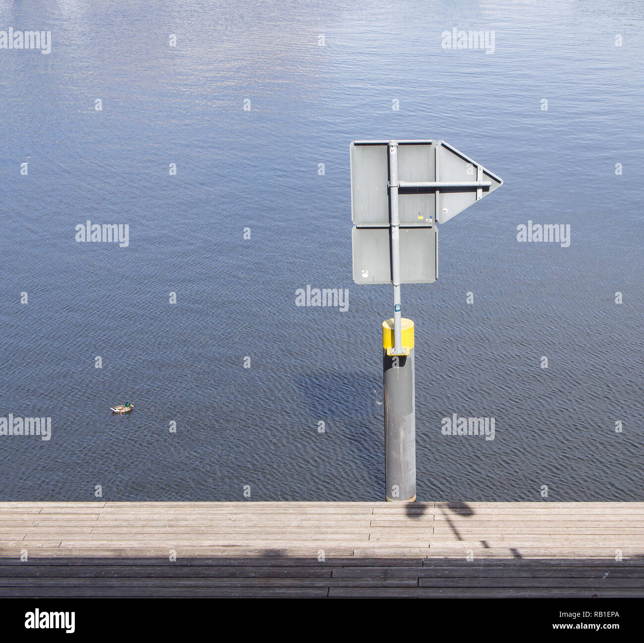Sign Post At The Water In Tempelhofer Hafen, Meaning Harbor of Tempelhof In German Language, In Berlin, Germany - Stock Image