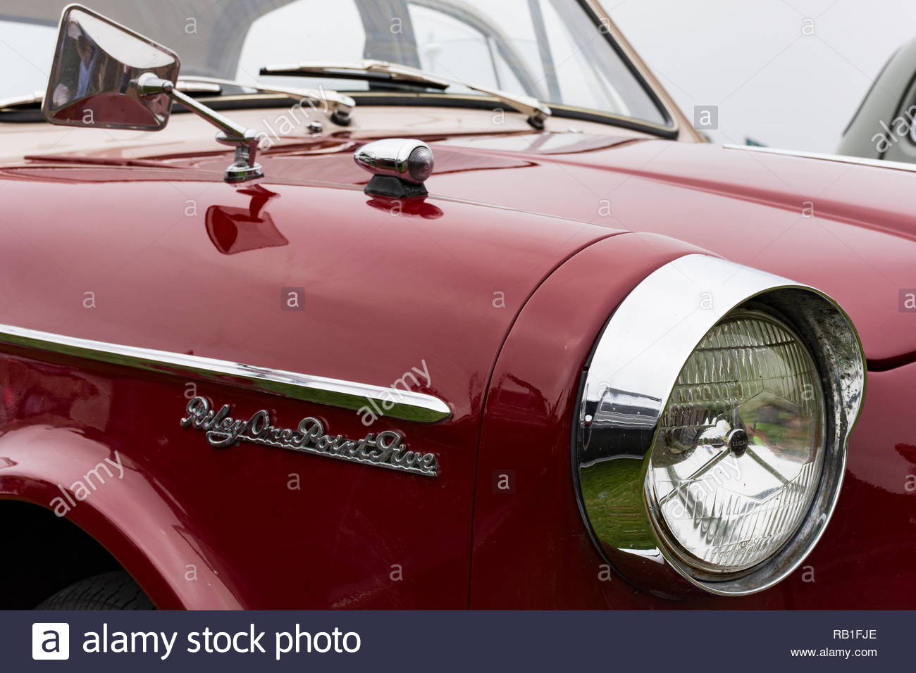 The front wing, headlight and wing mirror on an Austin Riley One Point Five being exhibited at the Vintage by the Sea event at Morecambe in 2018 - Stock Image