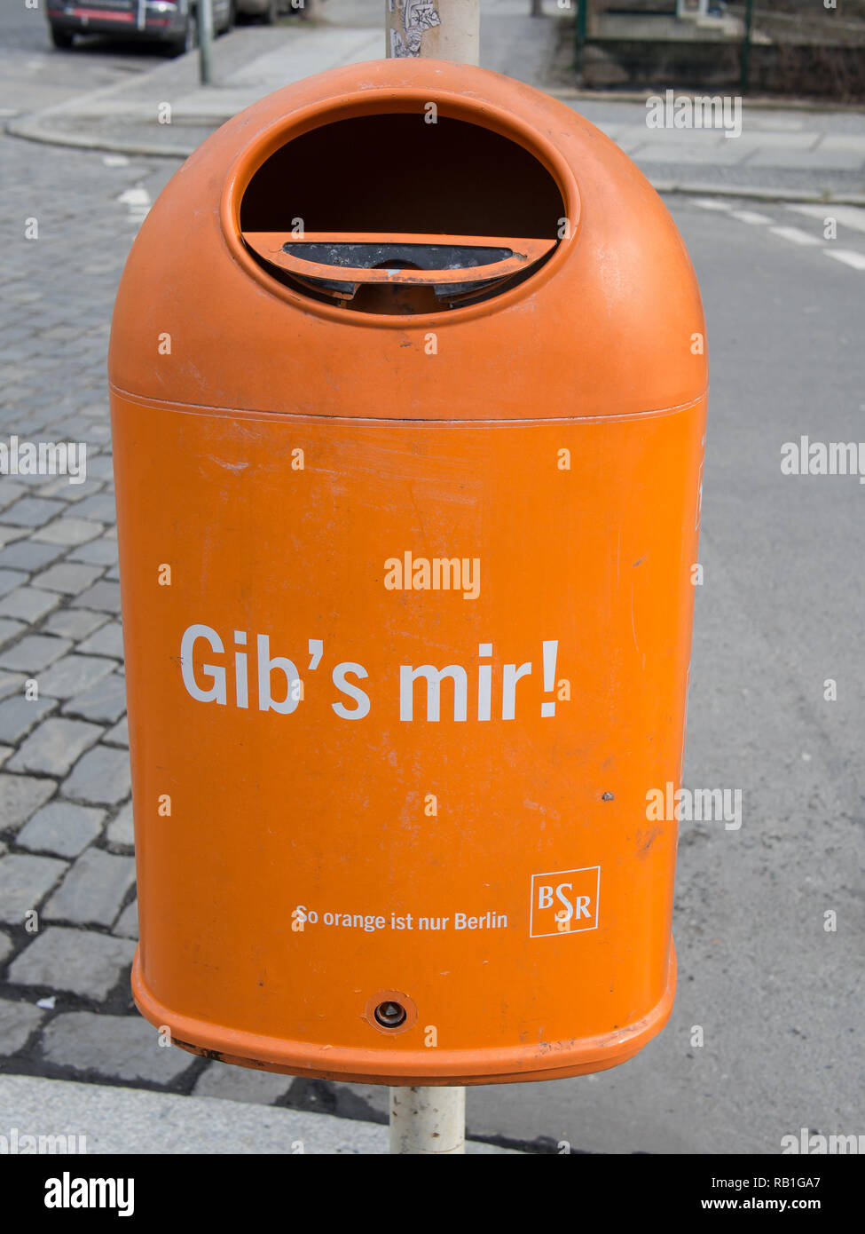 BERLIN, GERMANY - FEBRUARY 25, 2017: Orange Garbage Can With Text Give It To Me In German Language - Stock Image