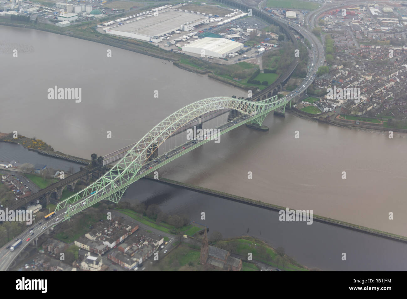 Flight over the Silver Jubilee bridge spanning Widnes and Runcorn prior to it's closure in 2017 - Stock Image
