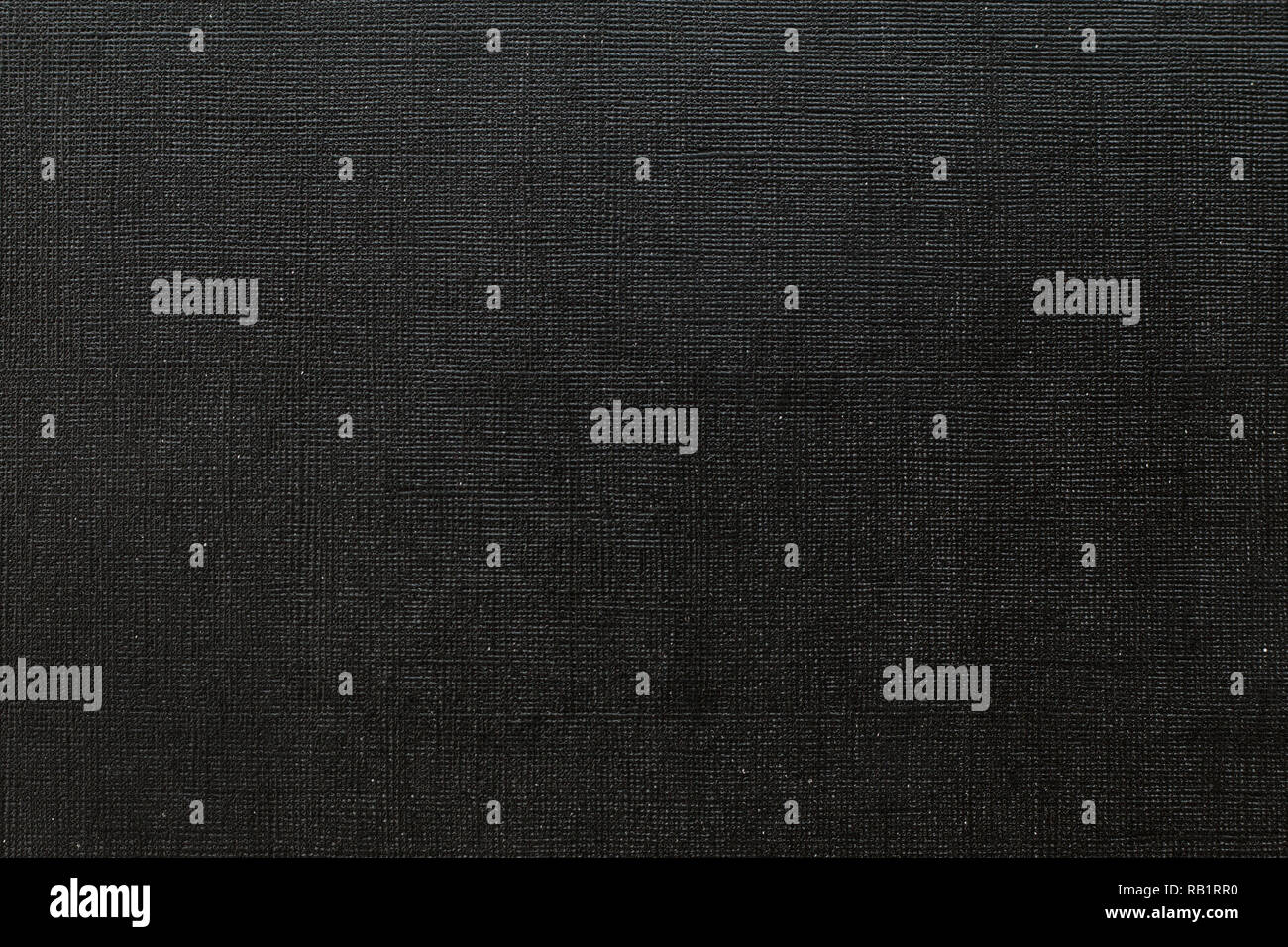 Deep black background with  grid pattern and white dots. Canvas texture of old book cover - Stock Image