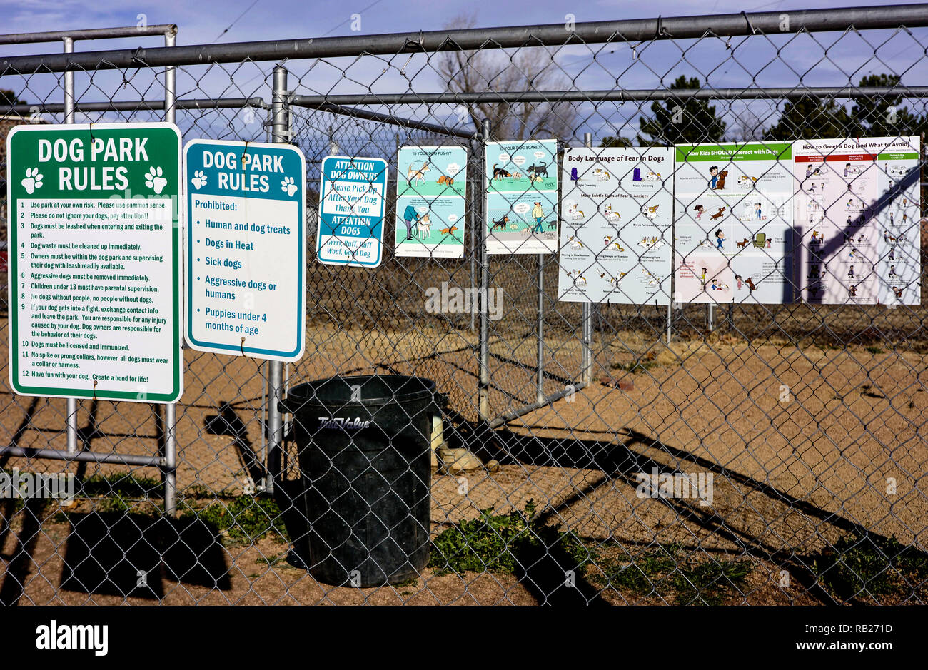 Posters showing the dog park rules situated in Alpine, Texas - Stock Image