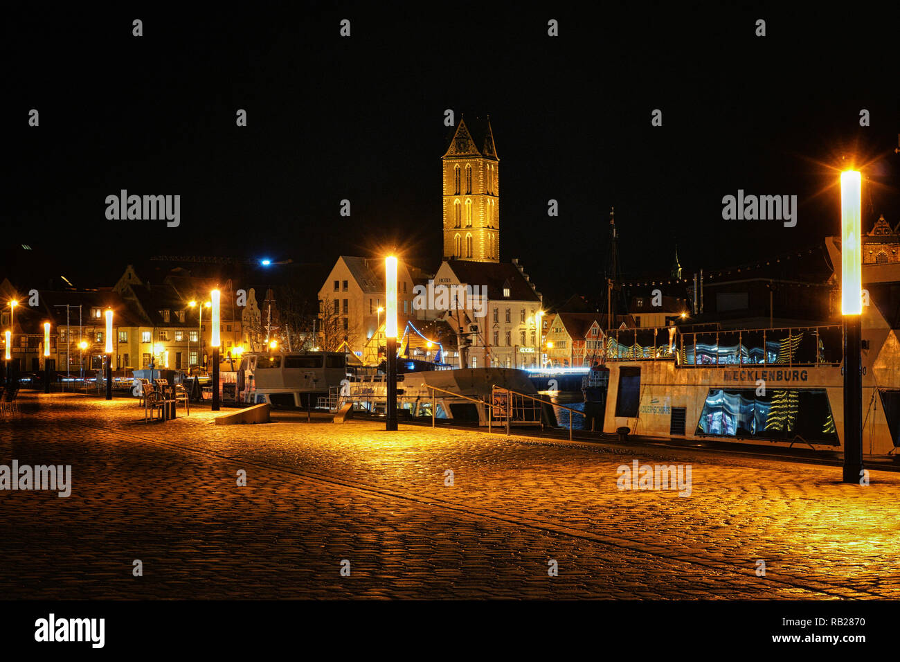Harbor in Wismar at the Baltic Sea at night. - Stock Image