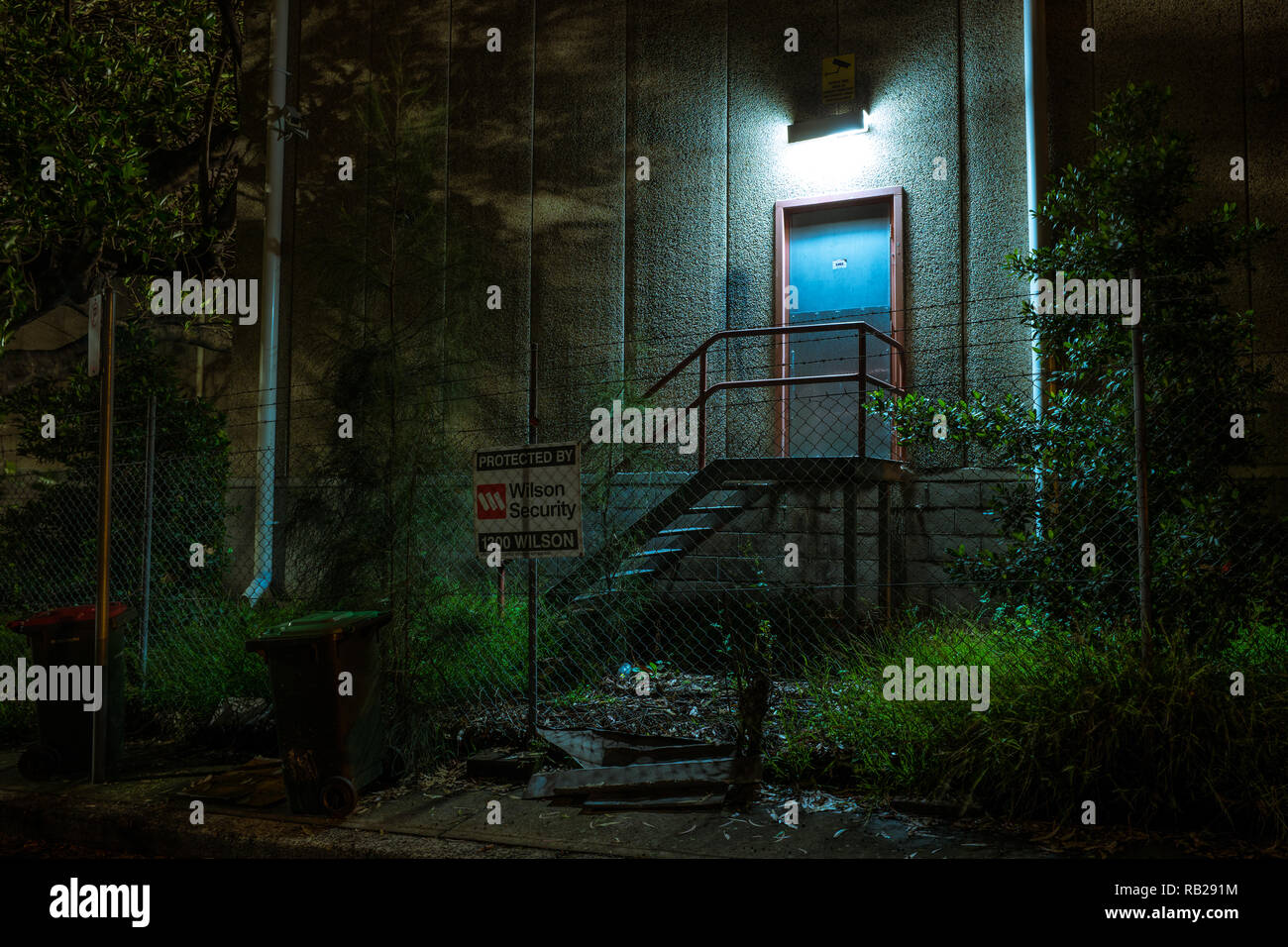 spooky blue door at night - Stock Image