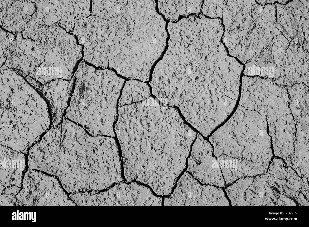 Cracked ground caused by drought in summer on top-view, detail textured and background - Stock Image