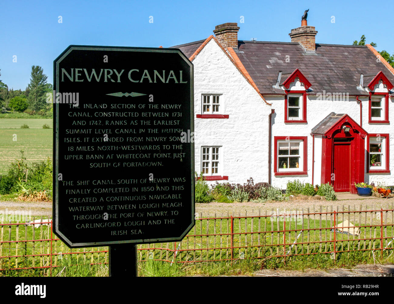 Newry Canal information sign at Moneypenny's Lock near Portadown, County Armagh. Moneypenny's Lockhouse is a restored canal lock house. - Stock Image